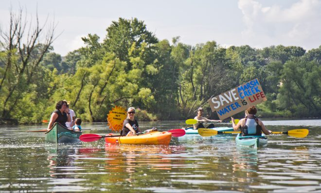 Protesters of Sunoco's Mariner East Pipline kayaked to a clean-up site on Marsh Creek Lake in Chester County, Pa., where the DEP says 8,000 gallons of drilling mud migrated into the stream.