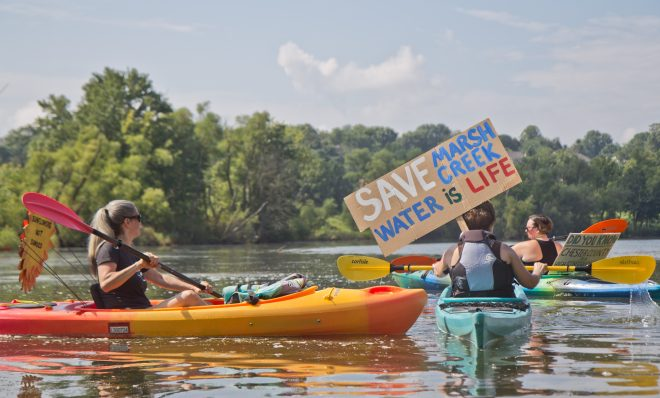 Protesters of Sunoco's Mariner East Pipline kayaked to a clean-up site on Marsh Creek Lake in Chester County, Pa., where an estimated 8,000 gallons of drilling mud migrated into the waterways.