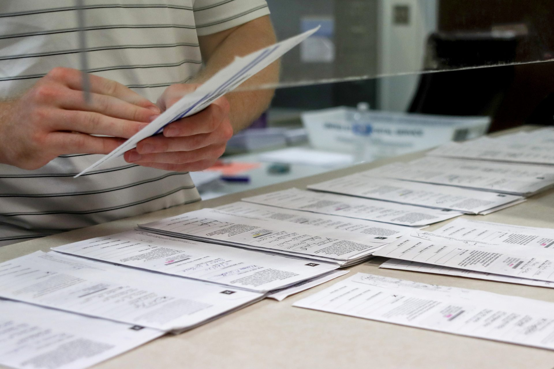 Butler County Bureau of Elections staff processes mailed ballots May 28, 2020, in Butler, Pa., ahead of the presidential primary June 2.