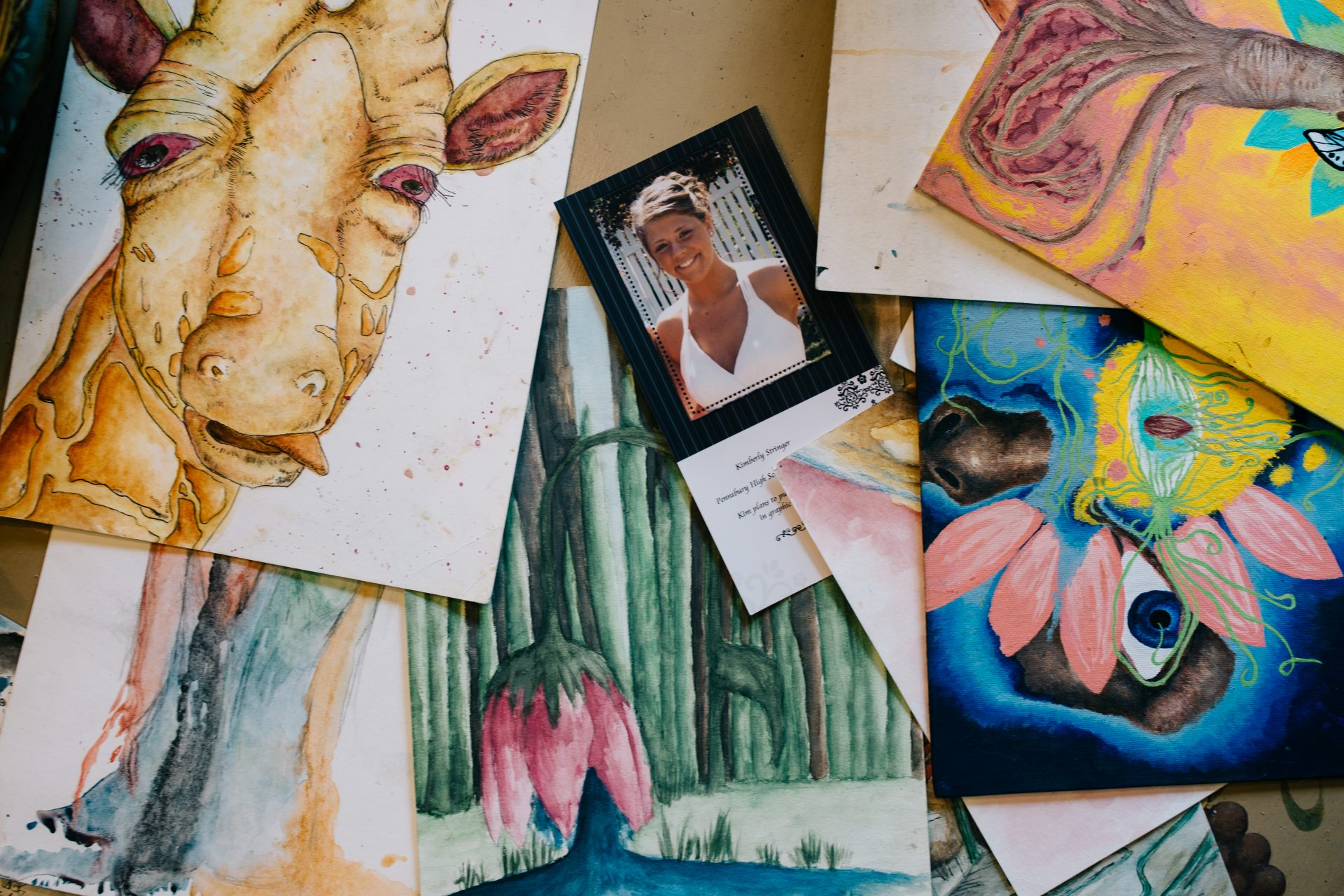 An assortment of Kimberly Stringer's art from when she was in school is displayed at her parents' home on Aug. 7, 2020. Paul and Martha Stringer noted that her art was the only thing Kimberly asked them to keep safe during her treatments.