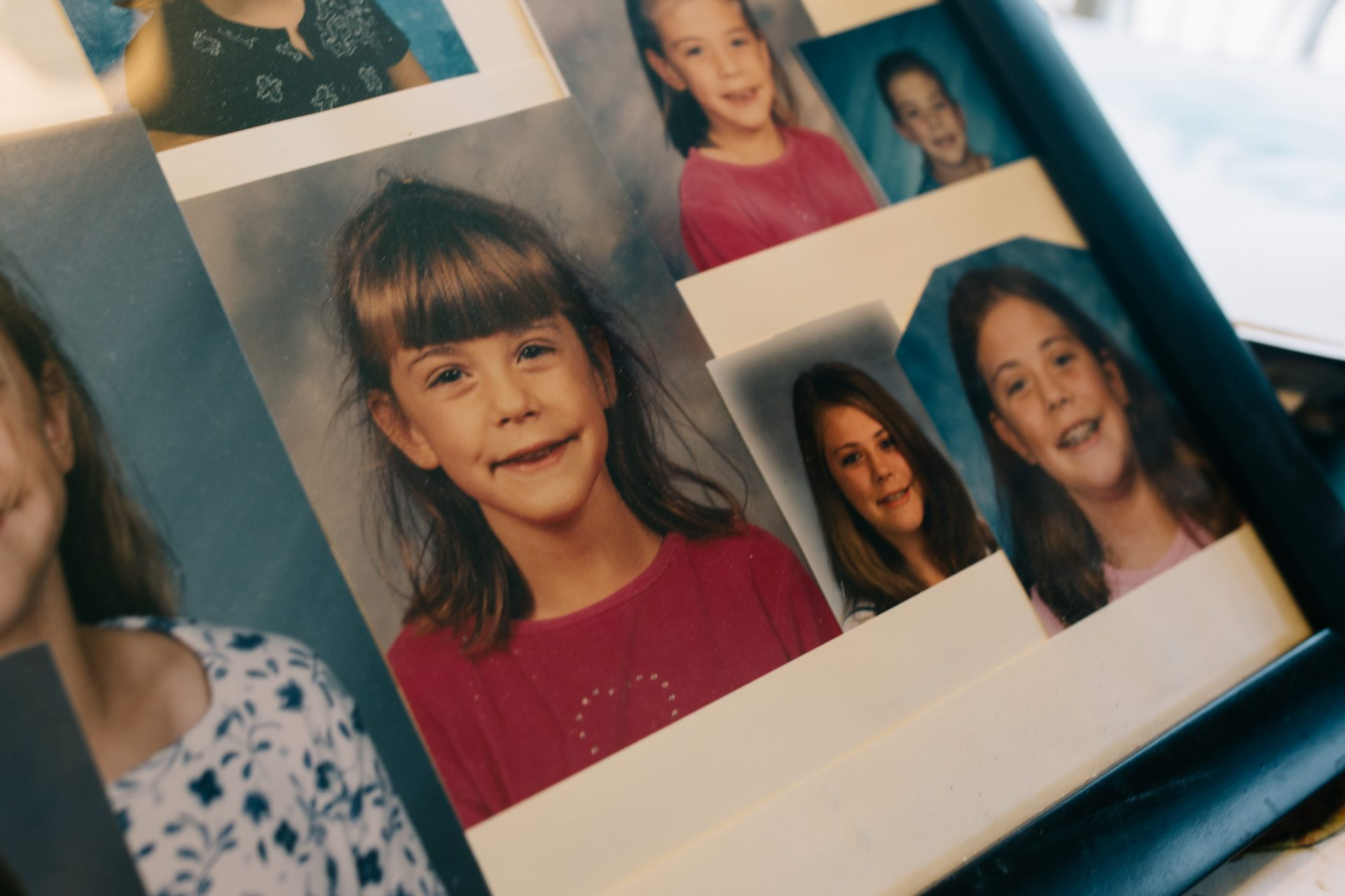 Photos of Kimberly Stringer throughout her childhood are displayed in the Stringer family's home in Morrisville, Pa., on Aug. 7, 2020.