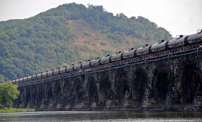 A tanker train crosses the Susquehanna River in Pennsylvania. A proposed new rule that would allow liquefied natural gas to be transported by rail is being challenged because safety and risk assessments have not been done.