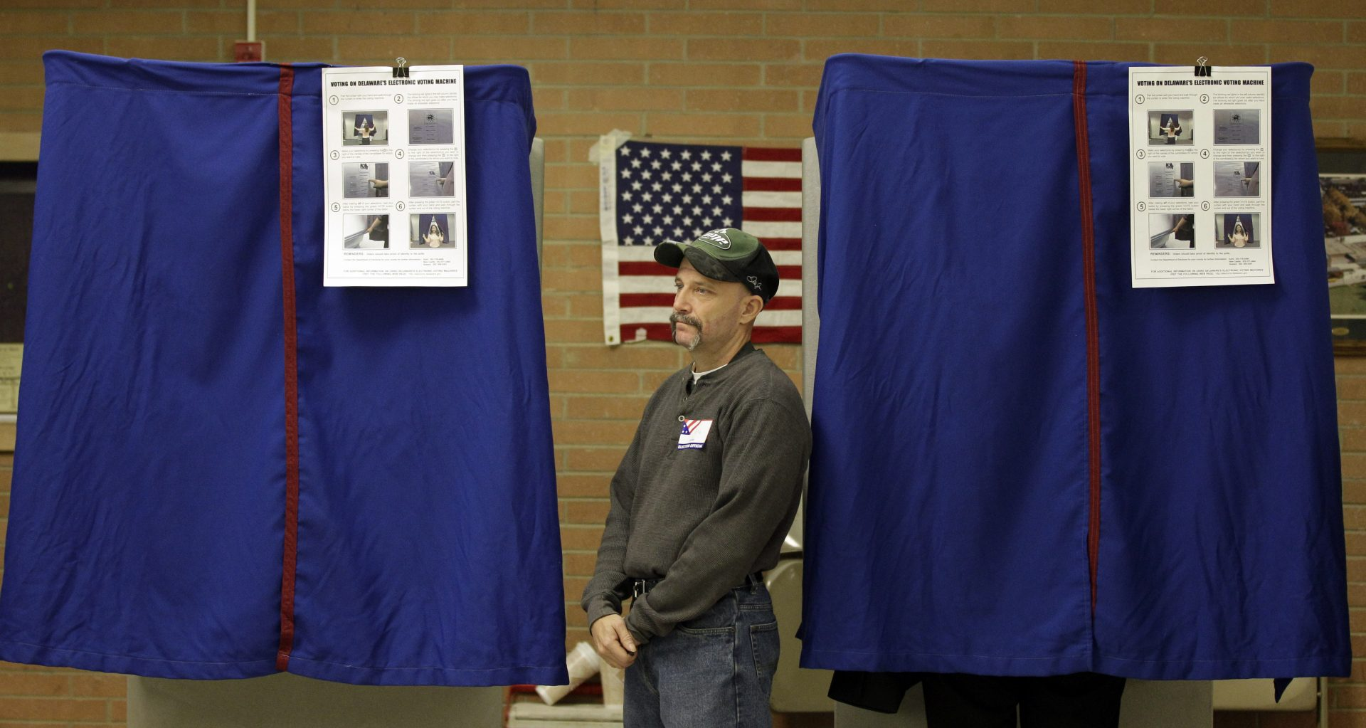 An election worker monitors a voting booth at a polling station in Wilmington, Del. Tuesday, Nov. 2, 2010.