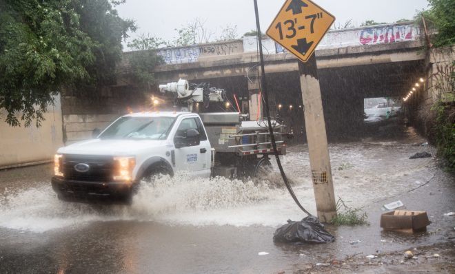A Philadelphia Water Department Vehicle closes down flooded Tulip and Lehigh streets during Isaias in Philadelphia.