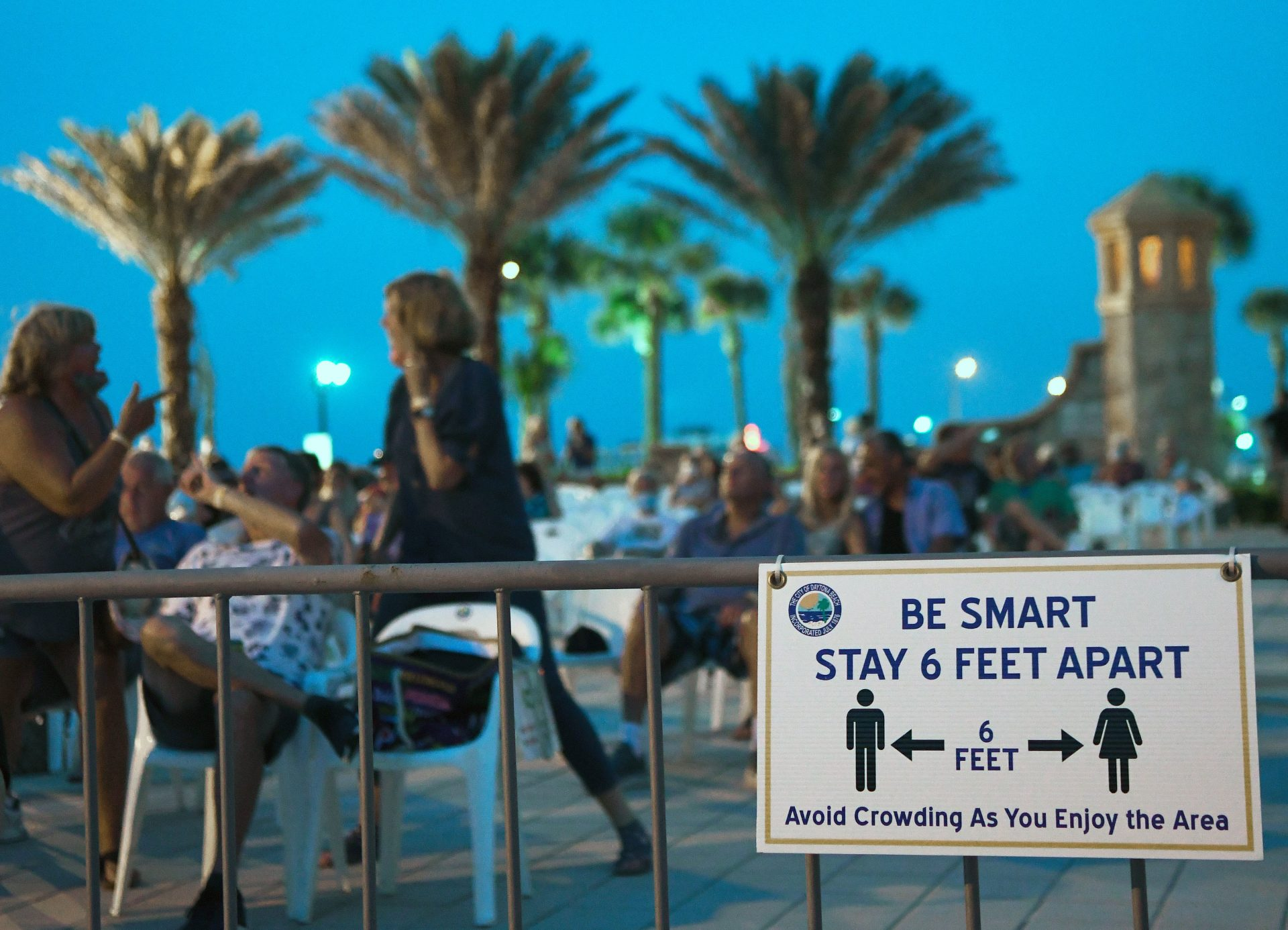 People attend a free concert at the Daytona Beach Bandshell on Labor Day weekend in Daytona Beach, Fla. For months, public health officials around the country have asked people to practice social distancing to slow the spread of the virus.