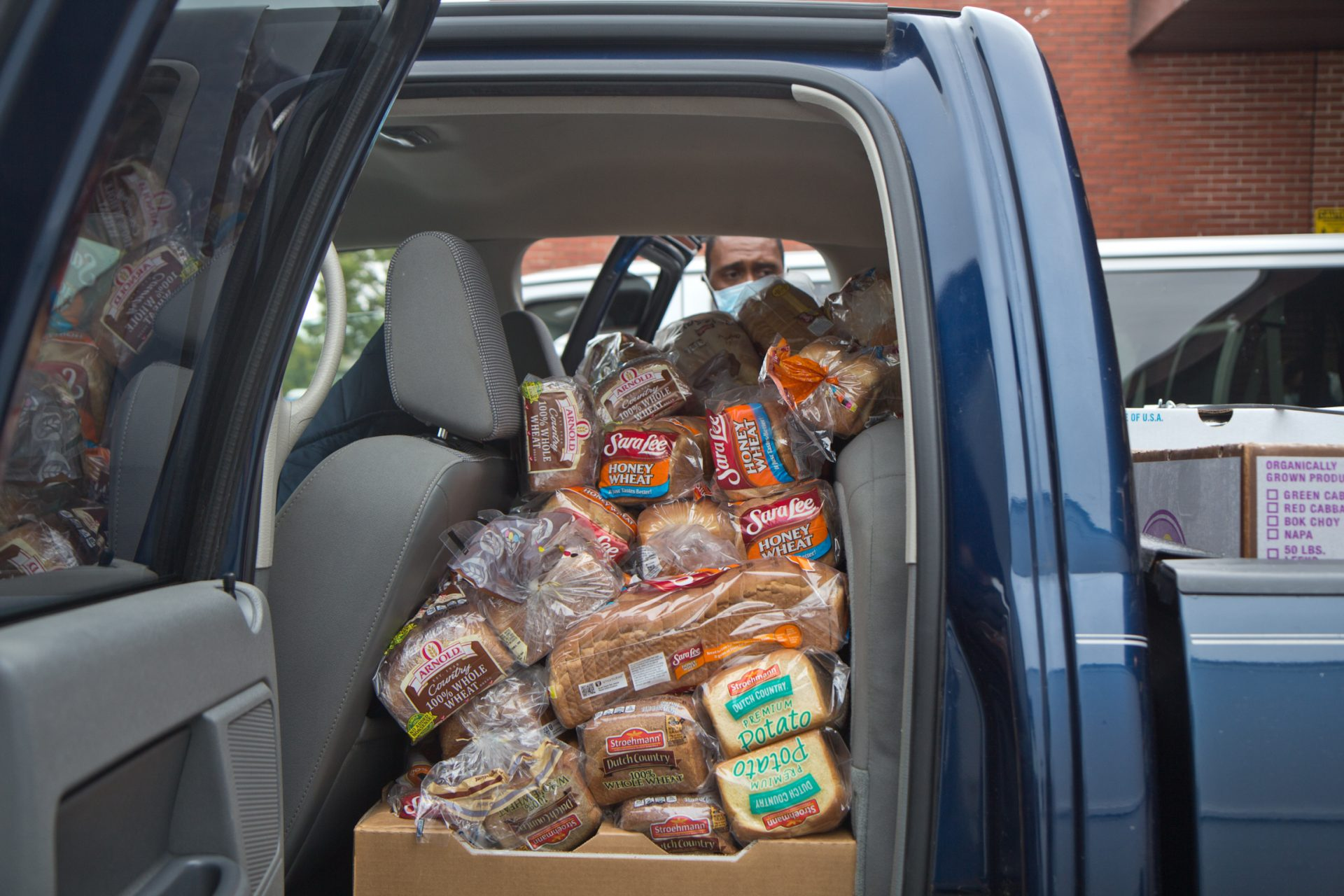 Shorter AME Baptist church members fill their truck with donations from Philabundance.