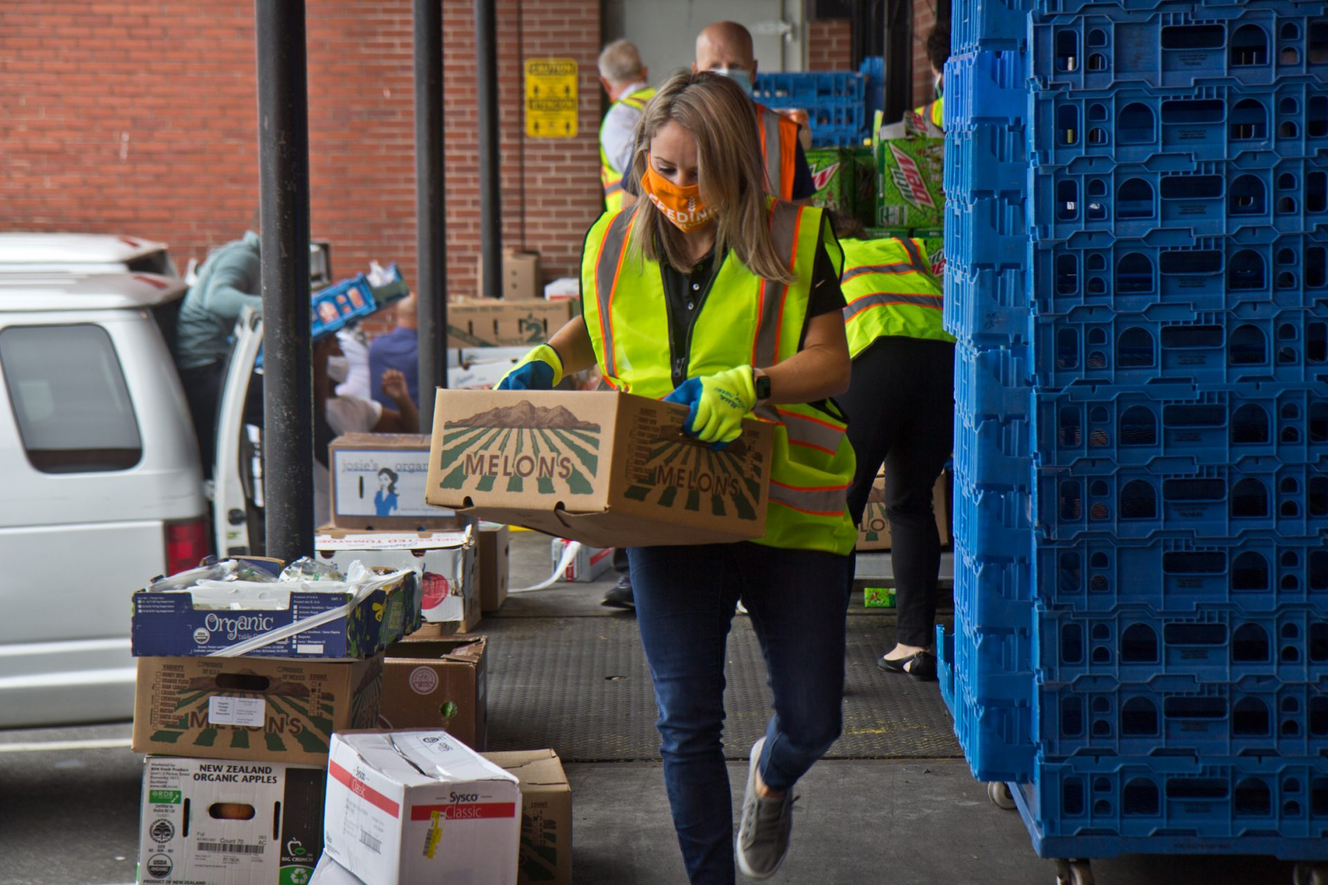Jane Clements-Smith, executive director of Feeding PA, helps load trucks at Philabundance's South Philly location.