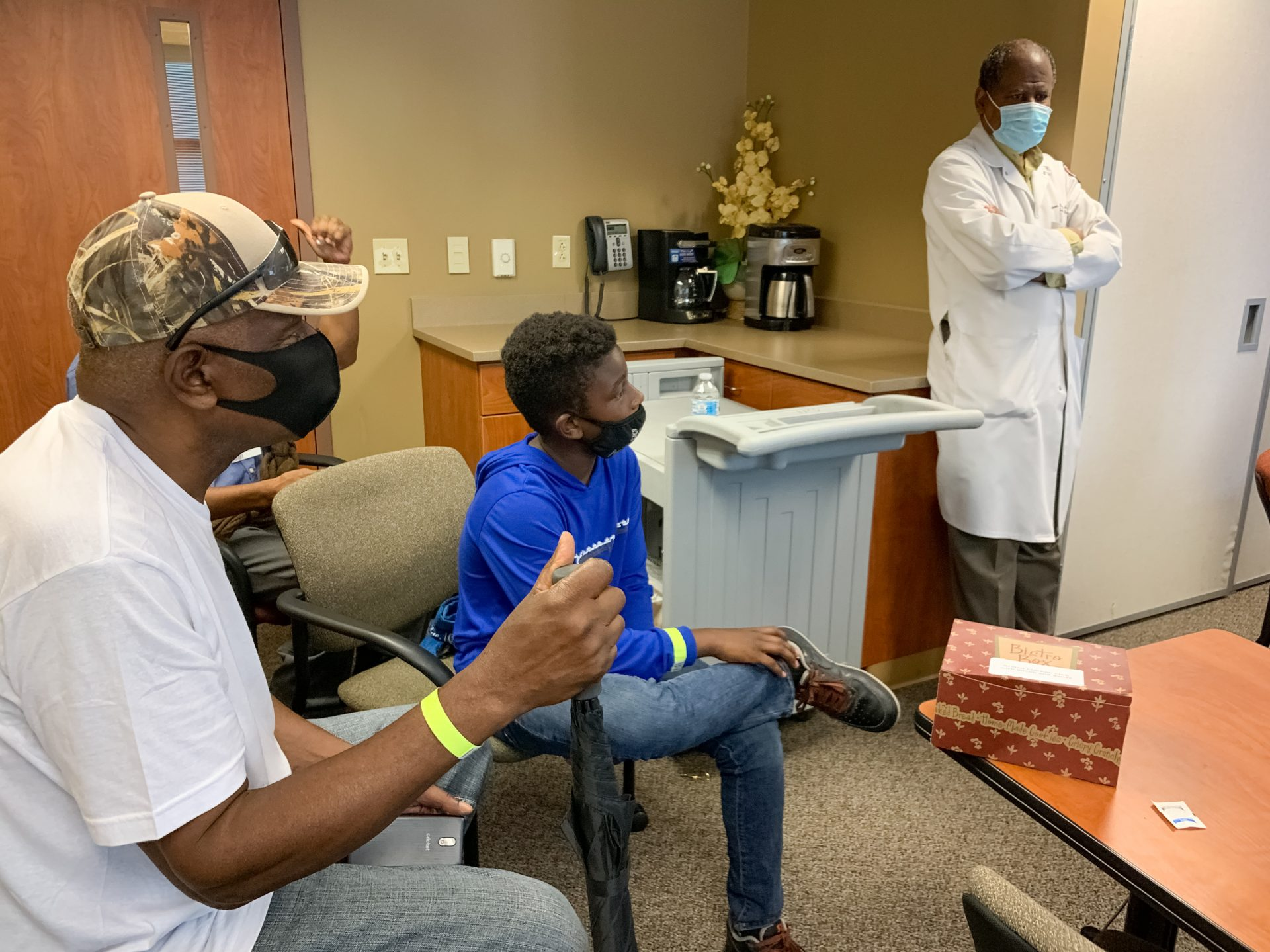 Robert Smith of Nashville listens to his long-time physician, Dr. Vladimir Berthaud of Meharry Medical College, explain the importance of Black patients participating in clinical trials for the COVID-19 vaccine. Berthaud is leading the site hosted at the historically black medical school.