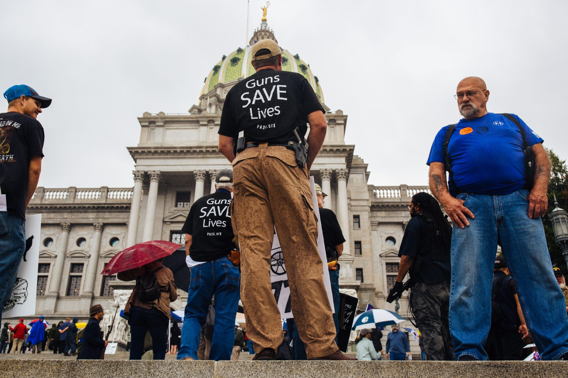 2nd Amendment Rally attendees carry guns and signs on the Capitol steps in Harrisburg, Pa., on September 29, 2020.