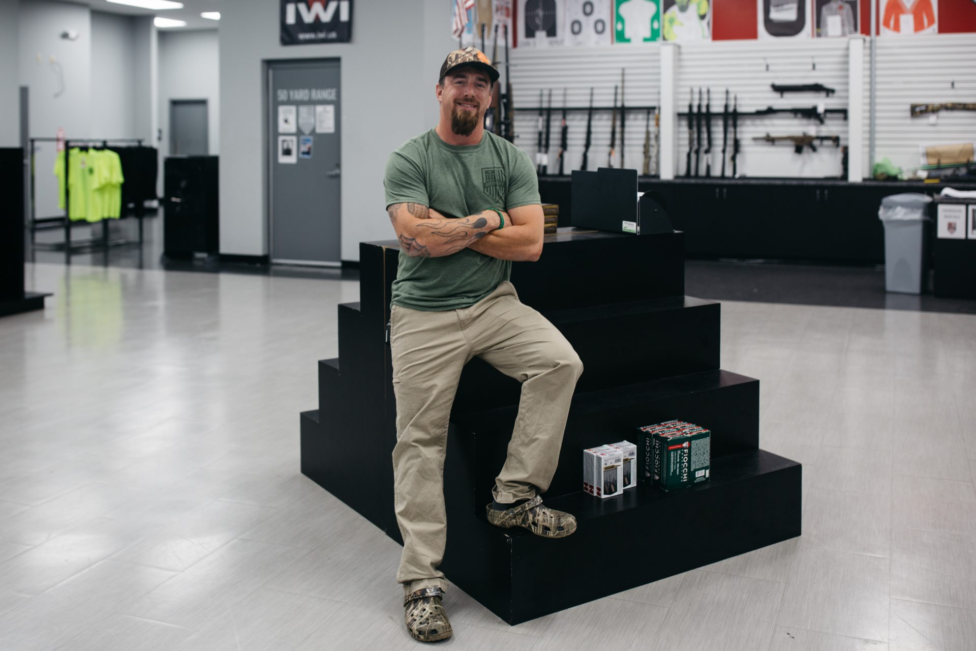 Patrick Connaghan, owner at 717 Armory in Harrisburg, Pa., leans on a nearly empty shelf of ammunition on Sept. 3, 2020. He said that ammunition and gun sales started surging on March 18, right after Gov. Tom Wolf declared a state of emergency.