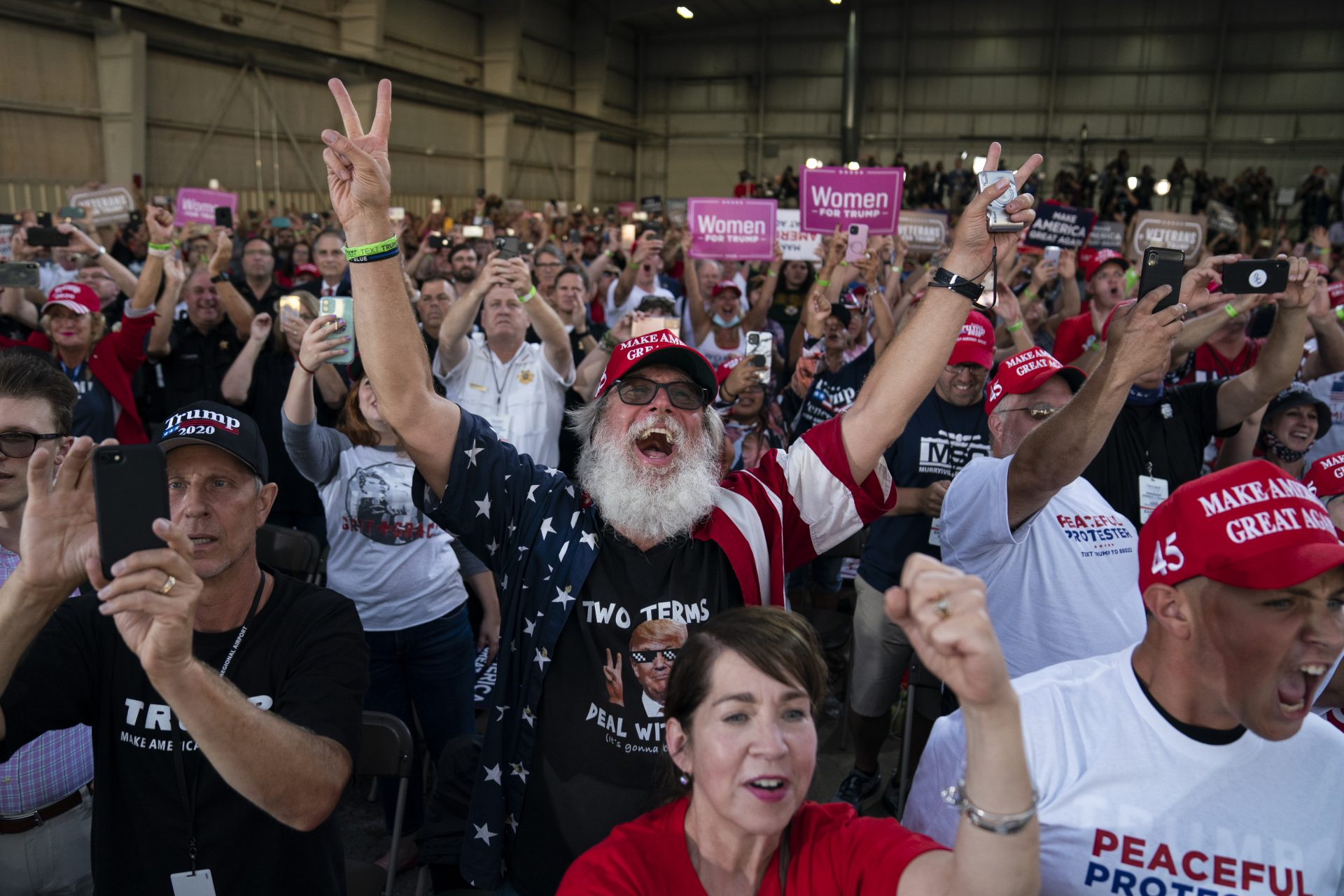 Supporters of President Donald Trump cheer as he arrives to speak during a campaign rally at Arnold Palmer Regional Airport, Thursday, Sept. 3, 2020, in Latrobe, Pa.