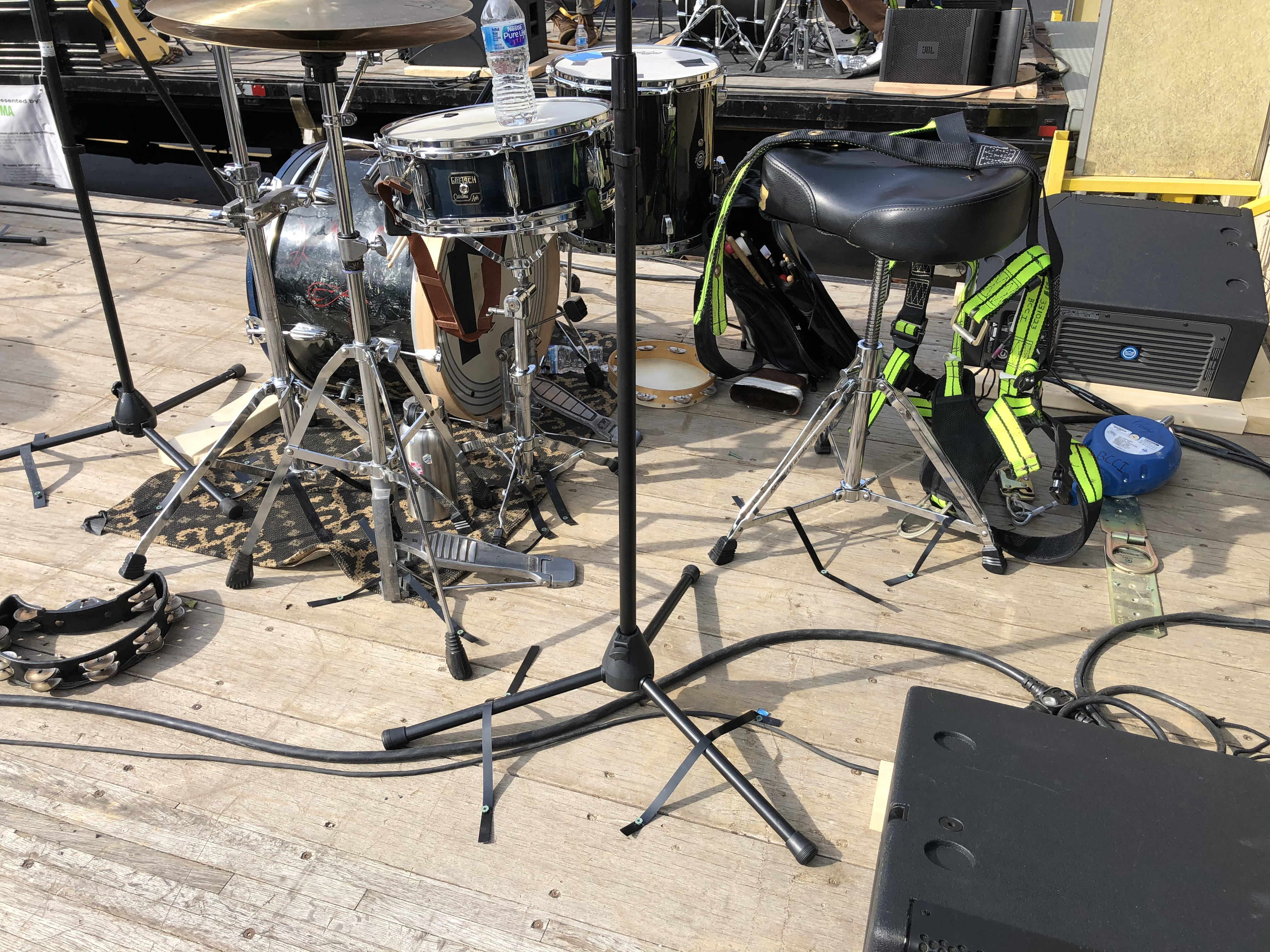 Music stands and gear strapped onto a flabed truck.