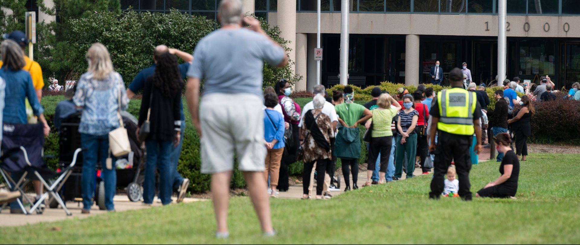 Voters wait in line to cast their ballot at an early voting location in Fairfax, Virginia on September 18, 2020. Growing tensions in the country have some election officials worried about potential violence at polling places.