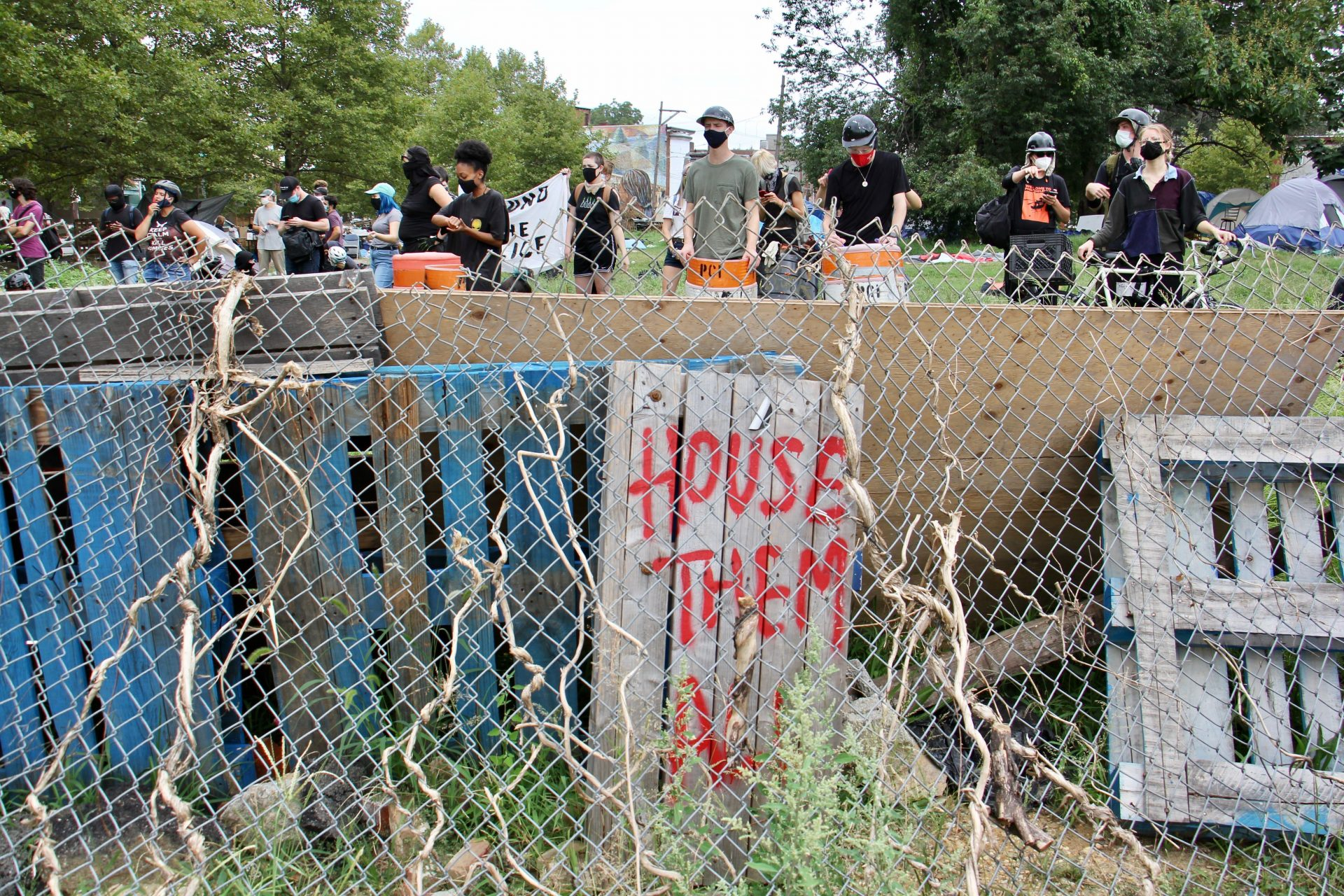 Protesters defend a homeless encampment on Ridge Avenue.