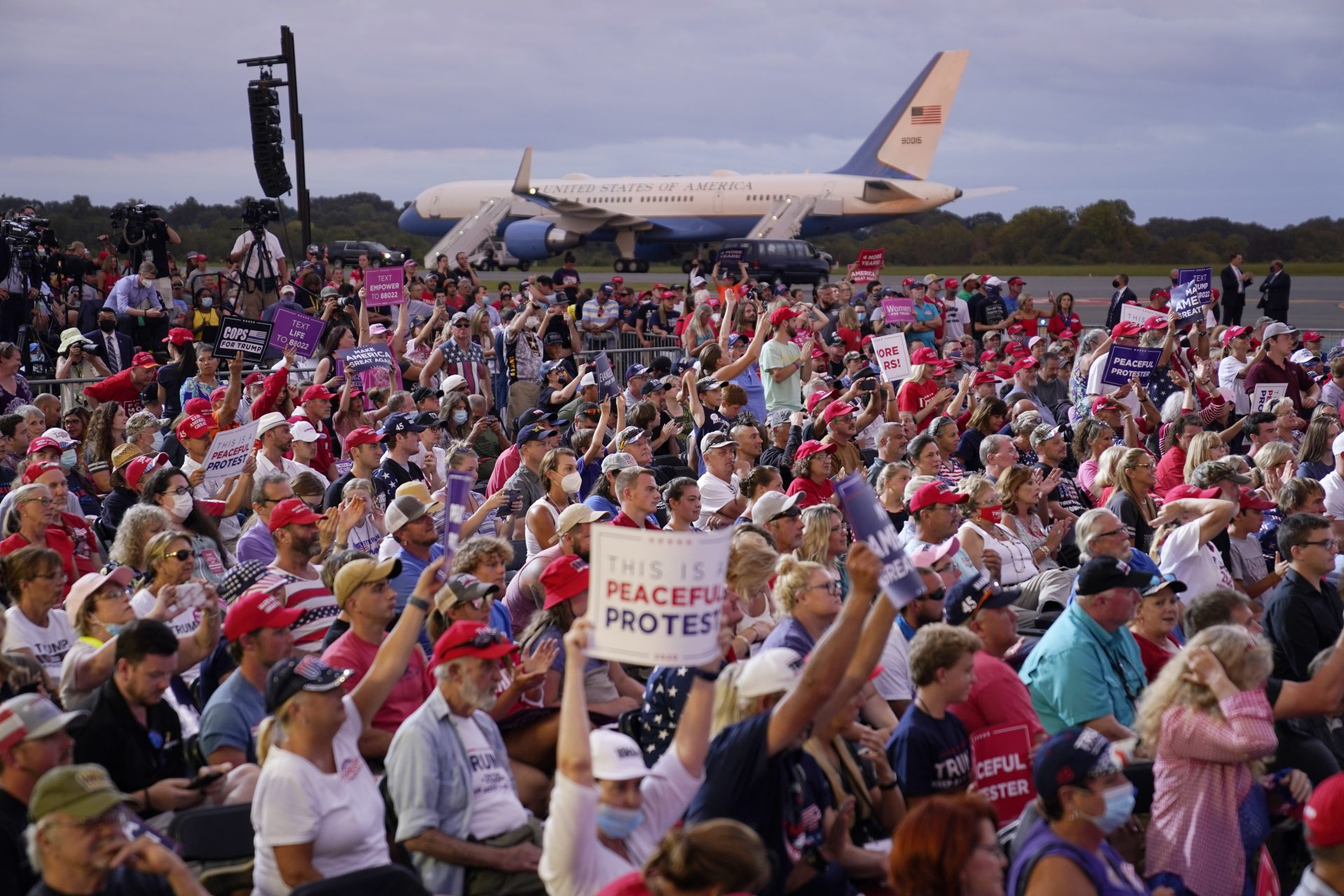 People cheer as President Donald Trump speaks during a campaign rally at Smith Reynolds Airport, Tuesday, Sept. 8, 2020, in Winston-Salem, N.C.