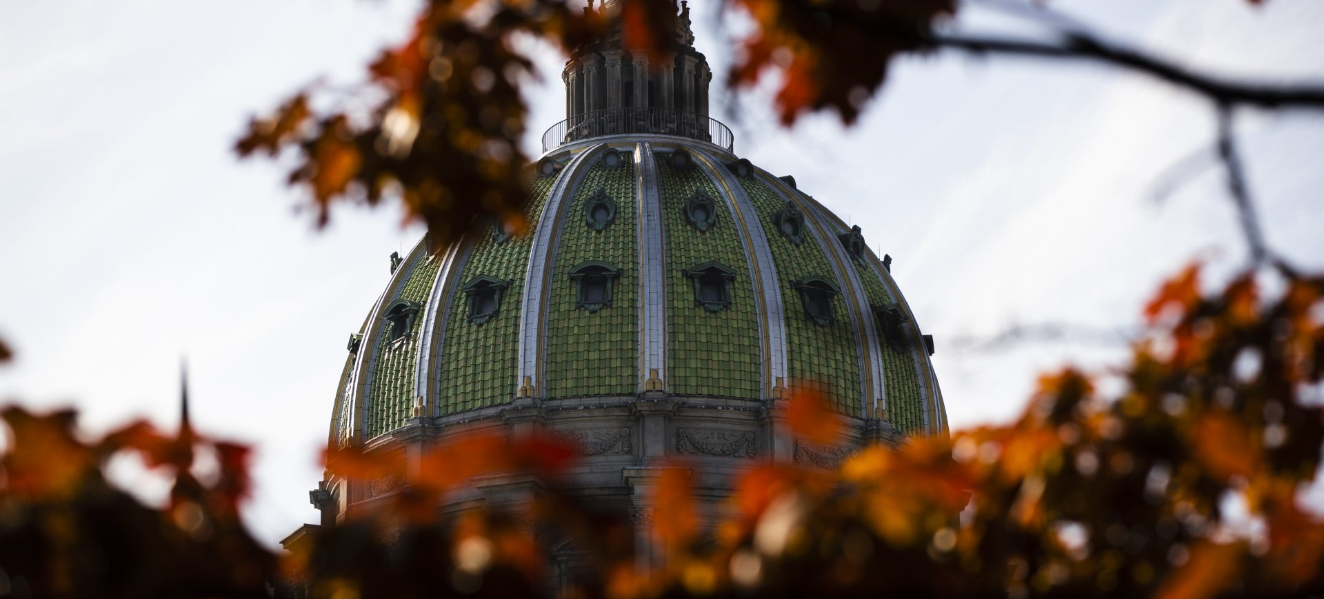 FILE PHOTO: In this file photo from Nov. 19, 2019, the dome of the Pennsylvania Capitol is visible through the fall trees in Harrisburg, Pa.