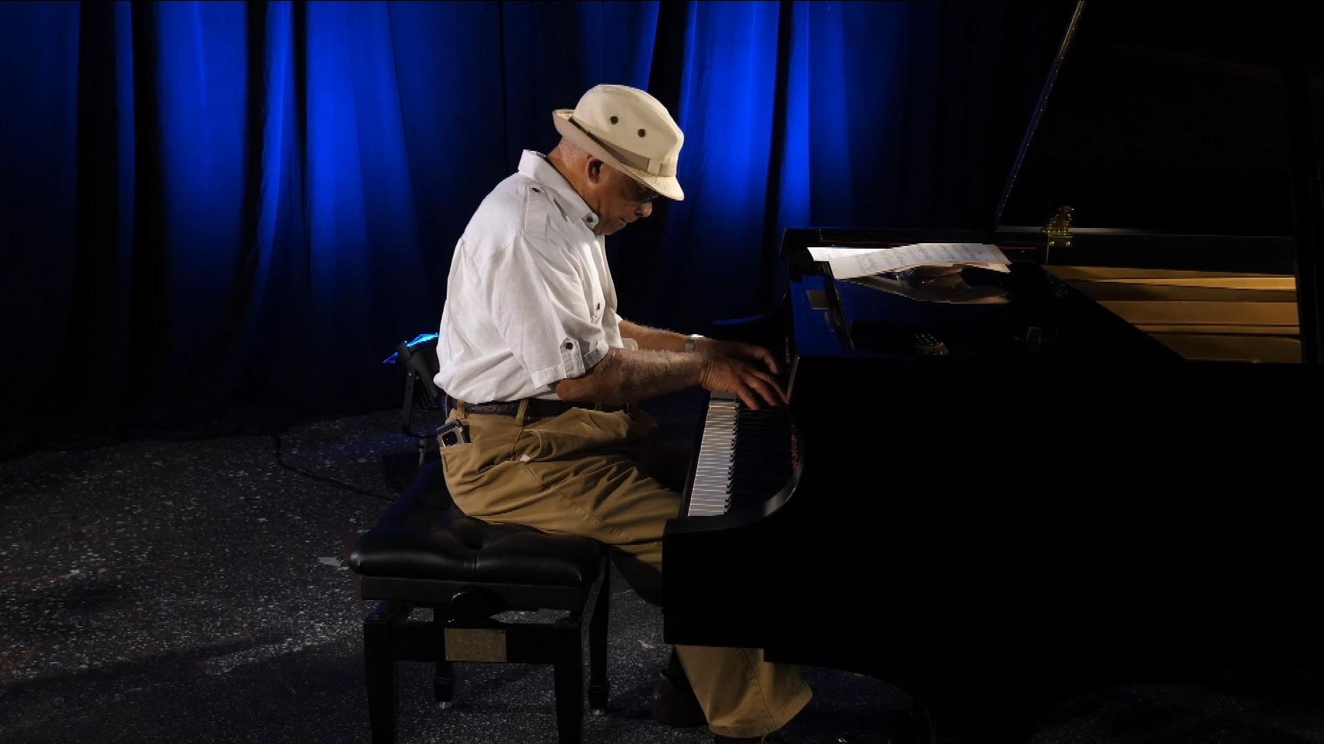 Jimmy Wood playing piano.