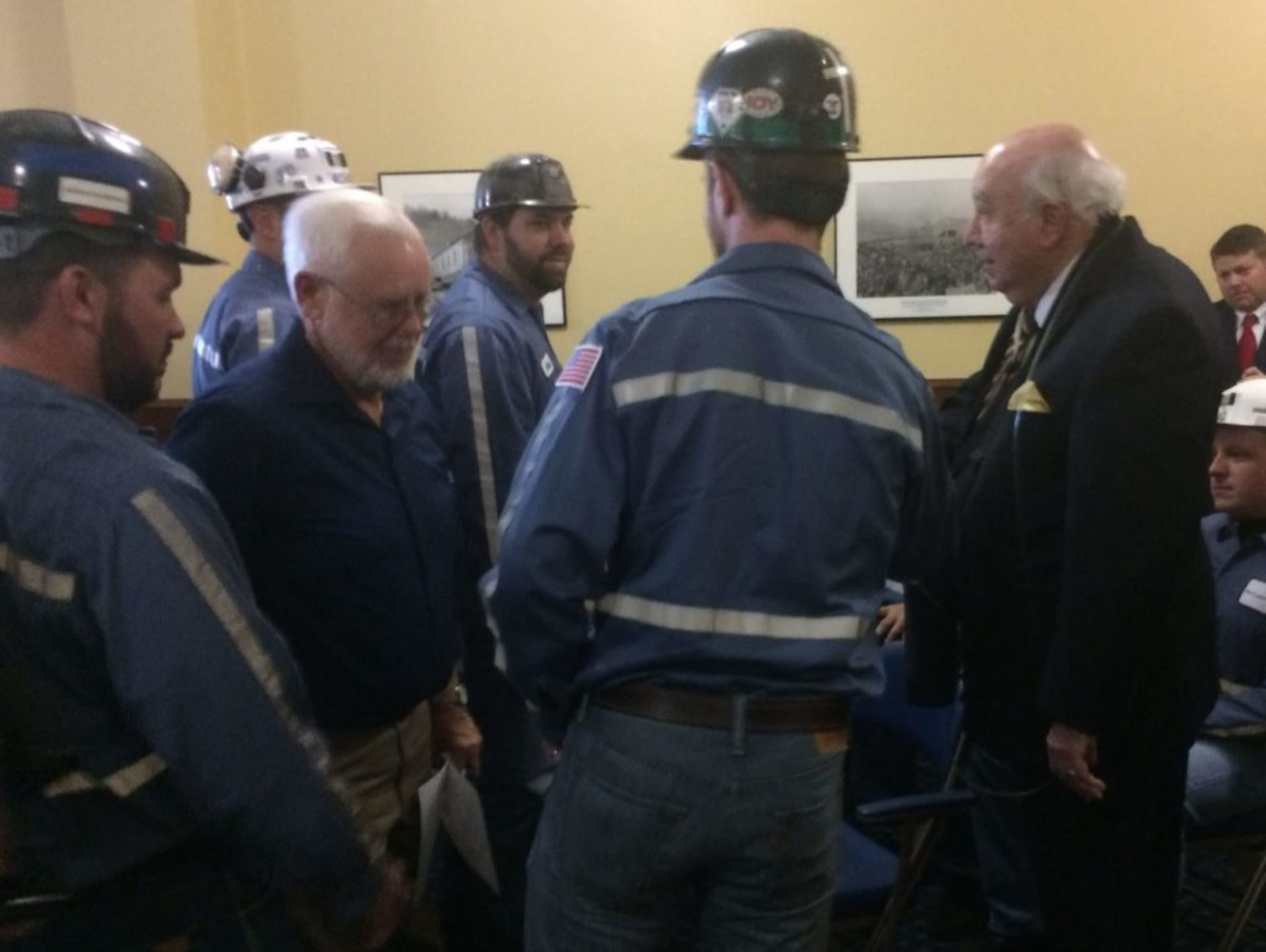 Murray Energy CEO Bob Murray, right, greets miners.