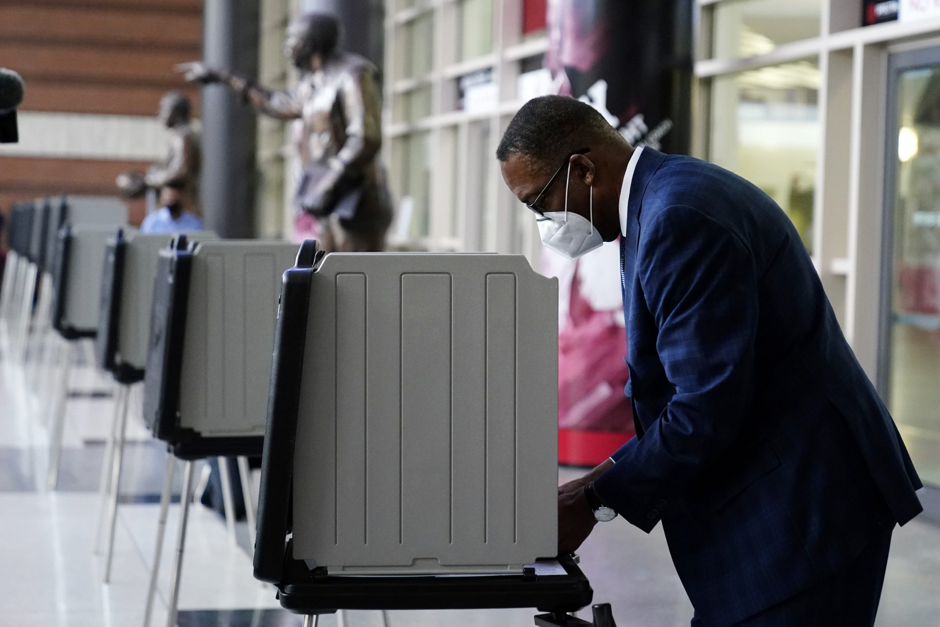 Philadelphia City Council President Darrell L. Clarke fills out his ballot at the opening of a satellite election office at Temple University's Liacouras Center, Tuesday, Sept. 29, 2020, in Philadelphia. P