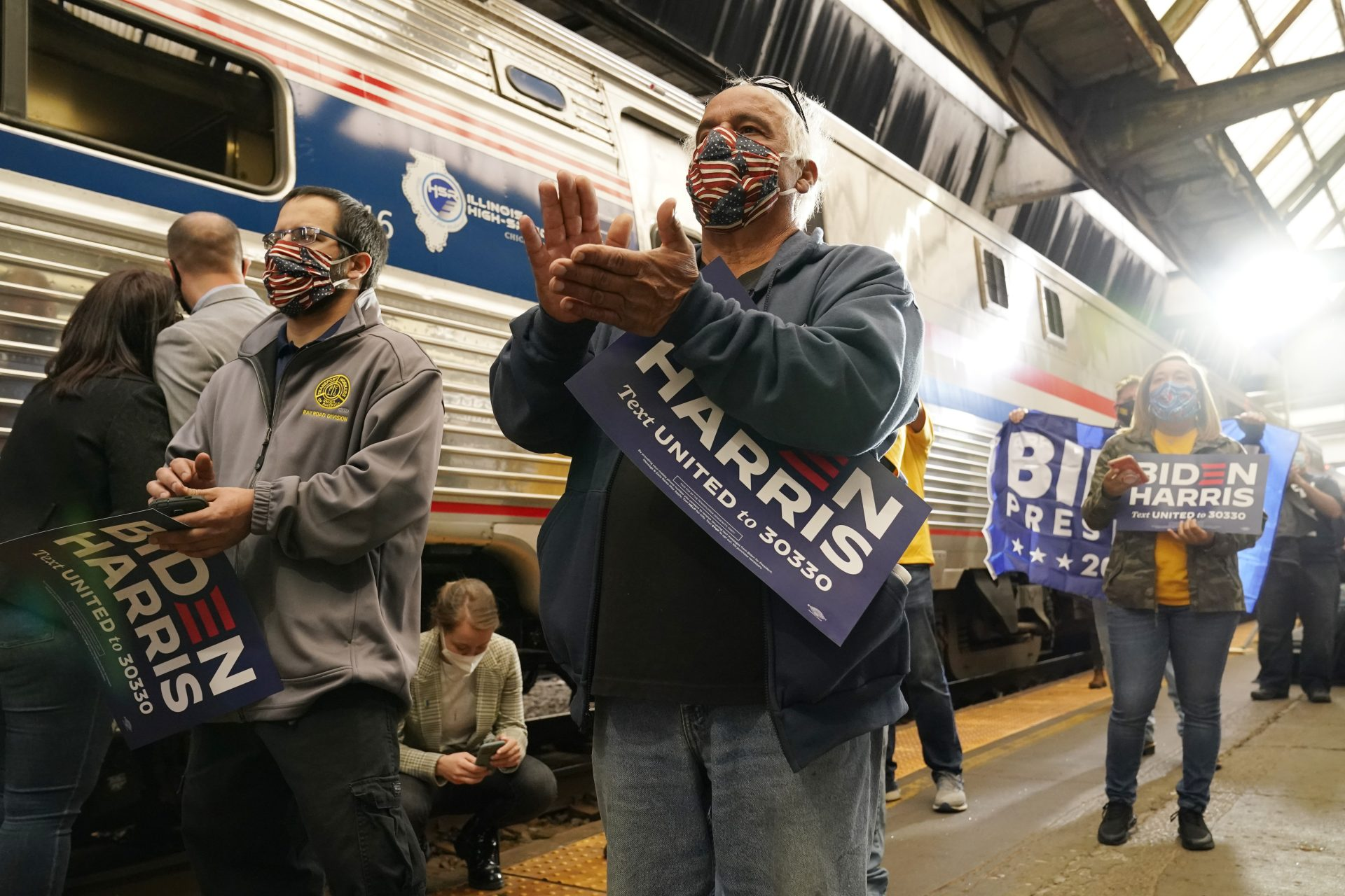 Supporters applaud as Democratic presidential candidate former Vice President Joe Biden speaks at Amtrak's Pittsburgh Train Station, Wednesday, Sept. 30, 2020, in Pittsburgh. Biden is on a train tour through Ohio and Pennsylvania today.