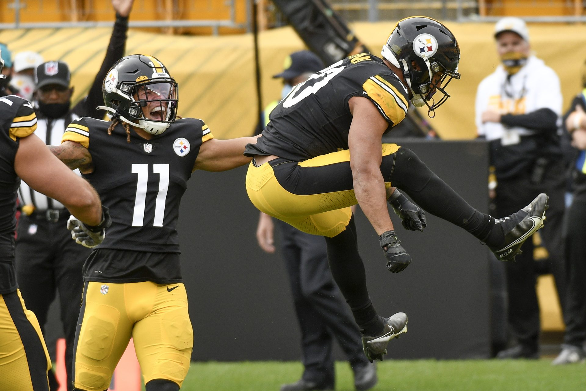 Pittsburgh Steelers running back James Conner (30) leaps after scoring a touchdown against the Cleveland Browns during the first half of an NFL football game, Sunday, Oct. 18, 2020, in Pittsburgh. Steelers wide receiver Chase Claypool (11) also reacts.