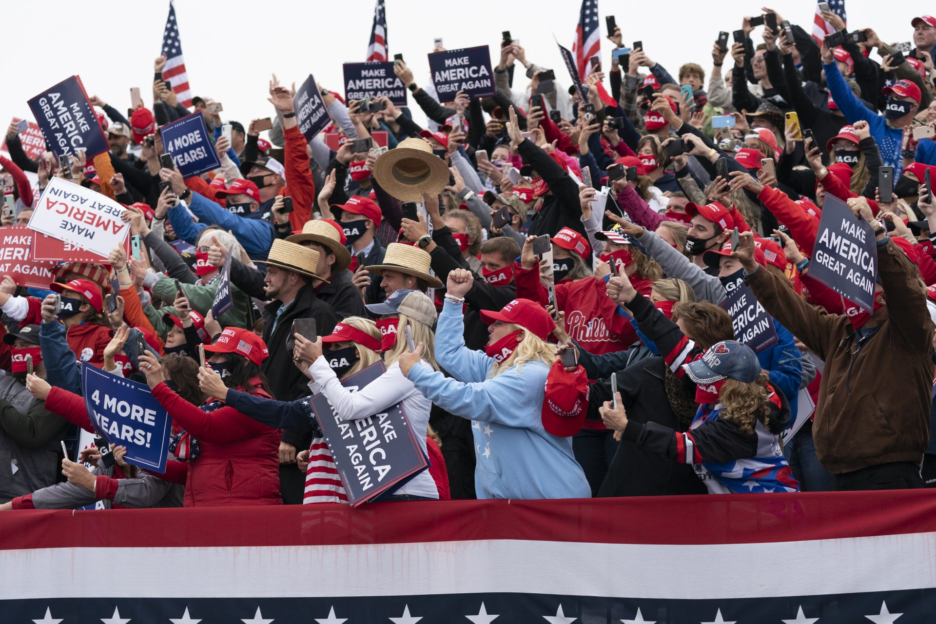 Supporters cheer before President Donald Trump speaks at a campaign rally at Lancaster Airport, Monday, Oct. 26, 2020, in Lititz, Pa.