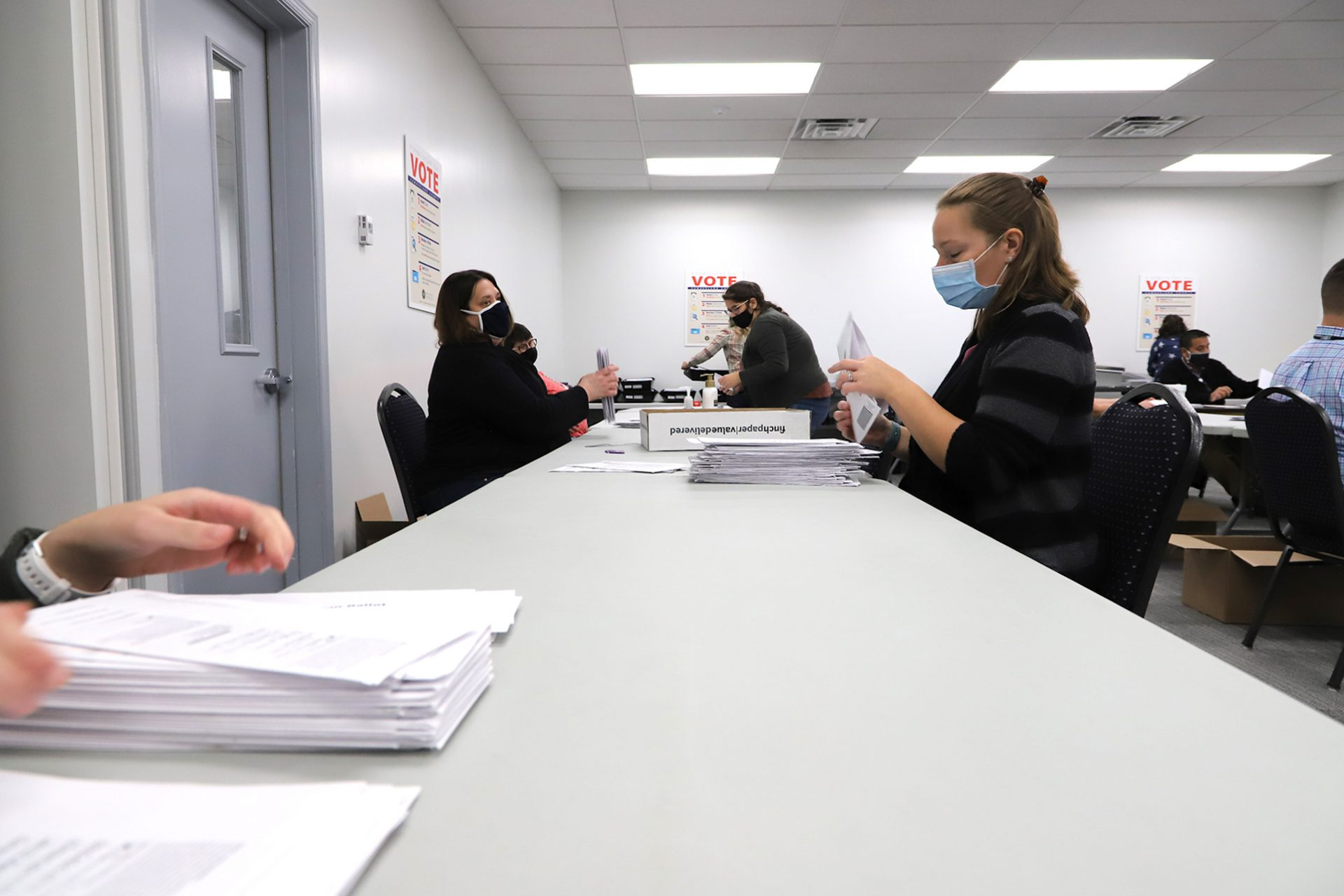 Workers process mail-in ballots at the Cumberland County Bureau of Elections on Nov. 4, 2020.