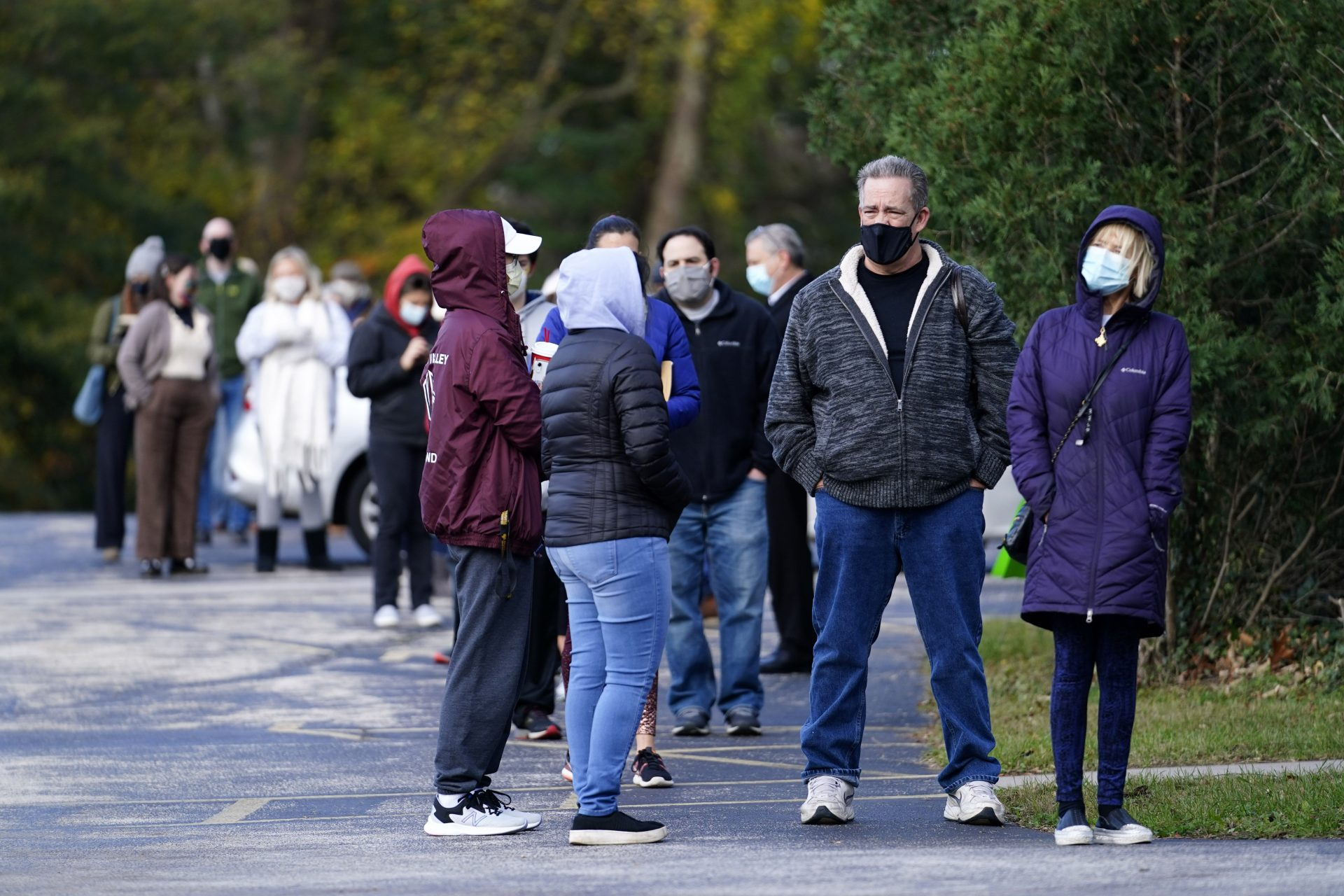 People wait outside a polling place to cast their ballots in the 2020 on Election Day, Tuesday, Nov. 3, 2020, in Media, Pa.