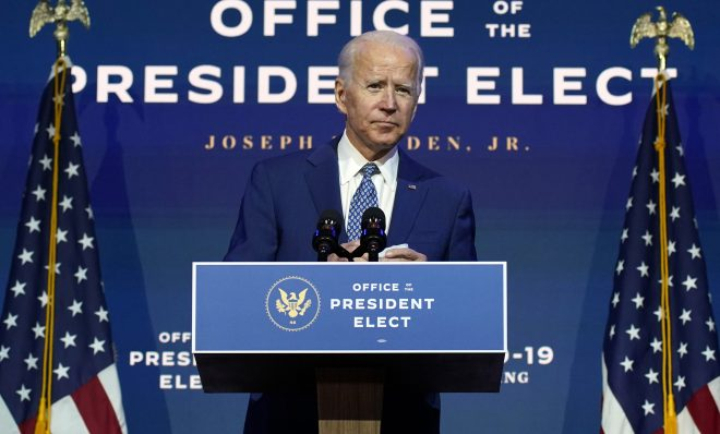 """In this Nov. 9, 2020, file photo President-elect Joe Biden speaks at The Queen theater in Wilmington, Del. Biden says he wants to """"restore the soul of America."""""""