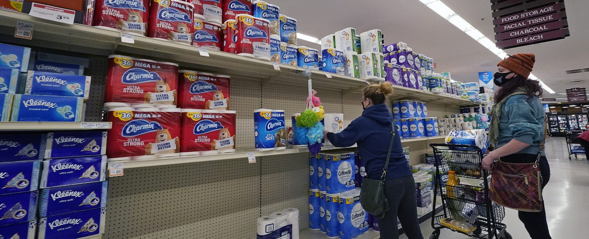 A woman buys toilet paper at a market in Mount Lebanon, Pa, on Tuesday, Nov. 17, 2020. Pennsylvania is strengthening its mask mandate and will require out-of-state travelers to test negative for the coronavirus before arrival. The state health secretary, Dr. Rachel Levine, said the new measures are in response to a sharp increase in infections and hospitalizations. She said Tuesday that masks are now required indoors wherever people from different households are gathered — even if they are physically distant. Like the rest of the nation, Pennsylvania has seen coronavirus infections explode in recent weeks.