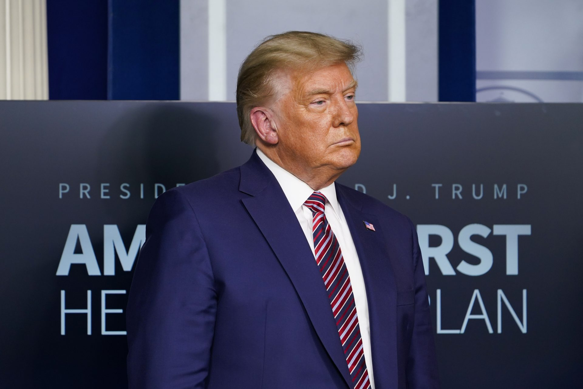 President Donald Trump listens during a news conference in the briefing room at the White House in Washington on Nov. 20, 2020.