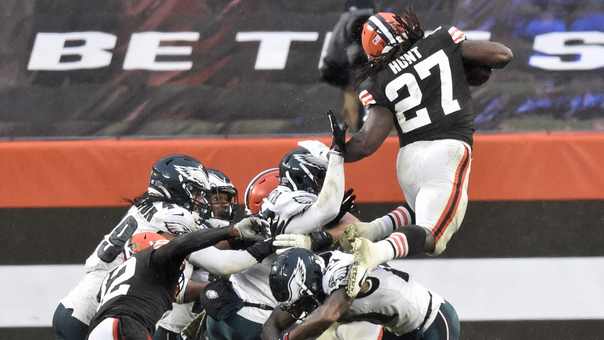 Cleveland Browns running back Kareem Hunt (27) rushes for a five-yard touchdown during the second half of an NFL football game against the Philadelphia Eagles, Sunday, Nov. 22, 2020, in Cleveland. The Browns won 22-17.