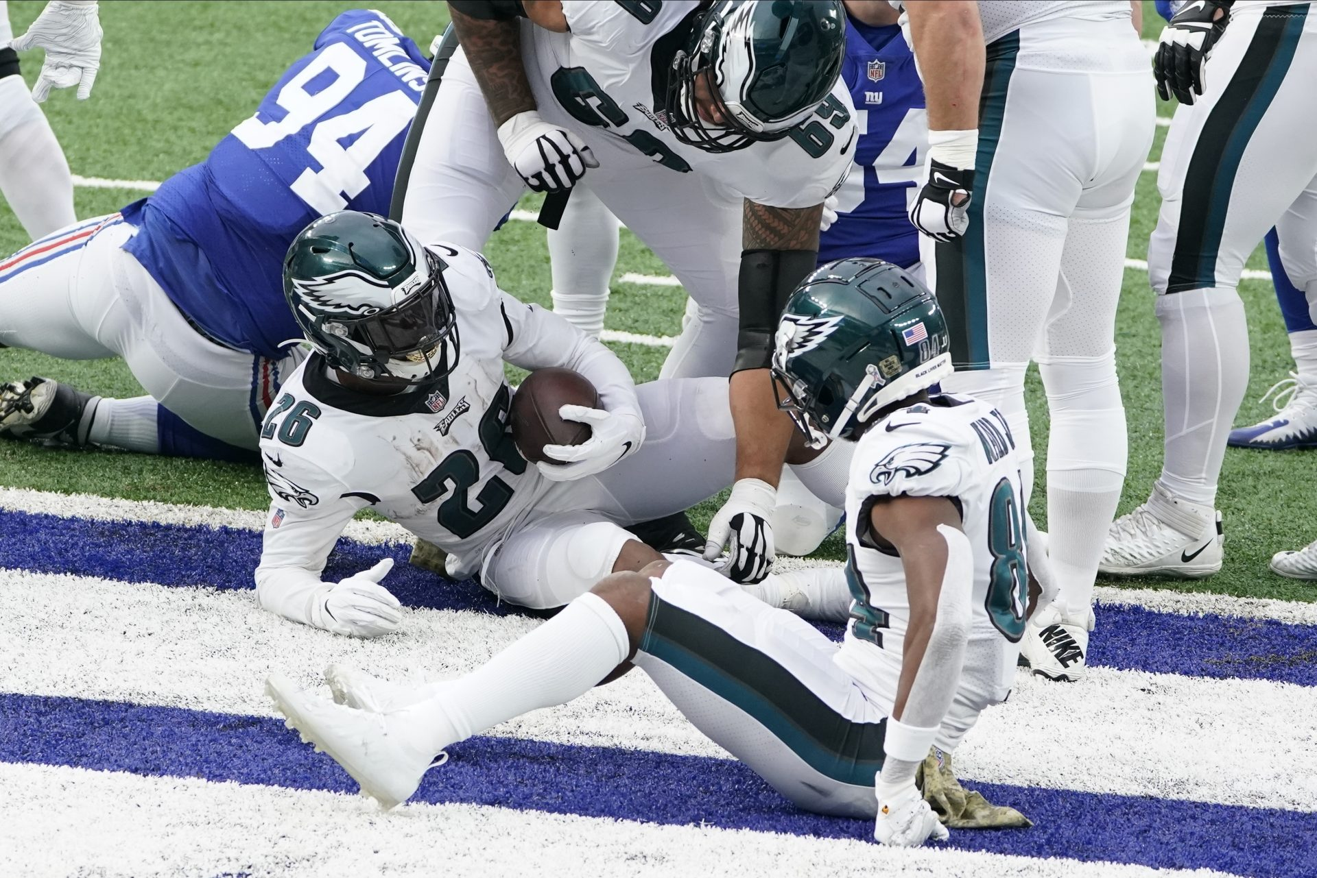 Philadelphia Eagles' Miles Sanders (26) scores a two-point conversion during the second half of an NFL football game against the New York Giants, Sunday, Nov. 15, 2020, in East Rutherford, N.J.