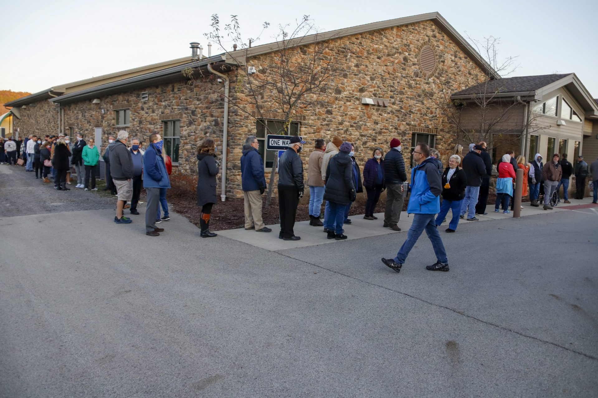 People line up completely surrounding the Jackson Township Municipal Building, in three separate lines alphabetically by last name, as the poll opened, Tuesday, Nov. 3, 2020, Election Day, in Jackson Township, Pa.