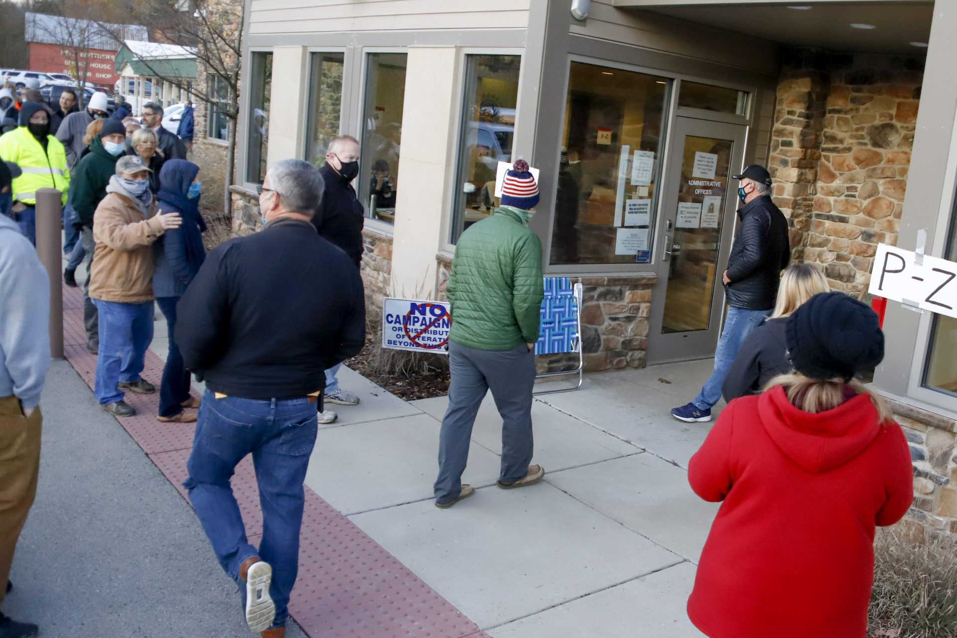 People lined up at the Jackson Township Municipal Building, start to enter the poll as it opens, Tuesday, Nov. 3, 2020, Election Day, in Jackson Township, Pa.