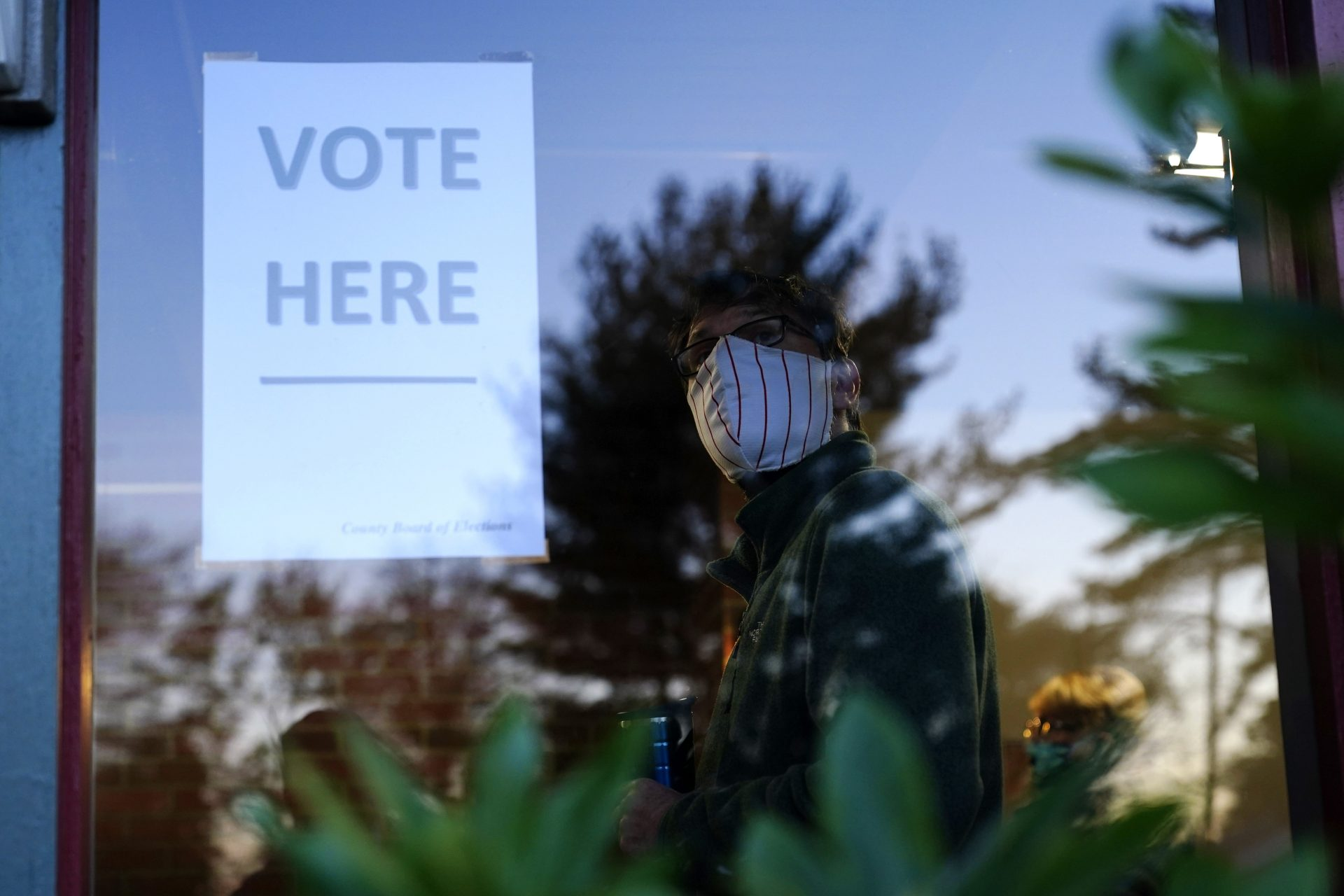 A voter lines up in a polling place to cast a ballot for the 2020 general election in the United States, Tuesday, Nov. 3, 2020, in Springfield, Pa.