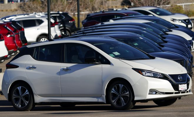A long line of unsold 2021 Leaf electric vehicles sits at a Nissan dealership Sunday, Nov. 8, 2020, in Highlands Ranch, Colo.