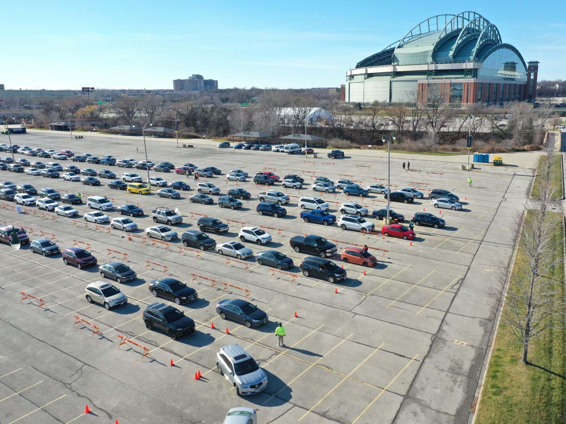 Residents line up in their cars Tuesday at a coronavirus test center on the grounds of Miller Park in Milwaukee.