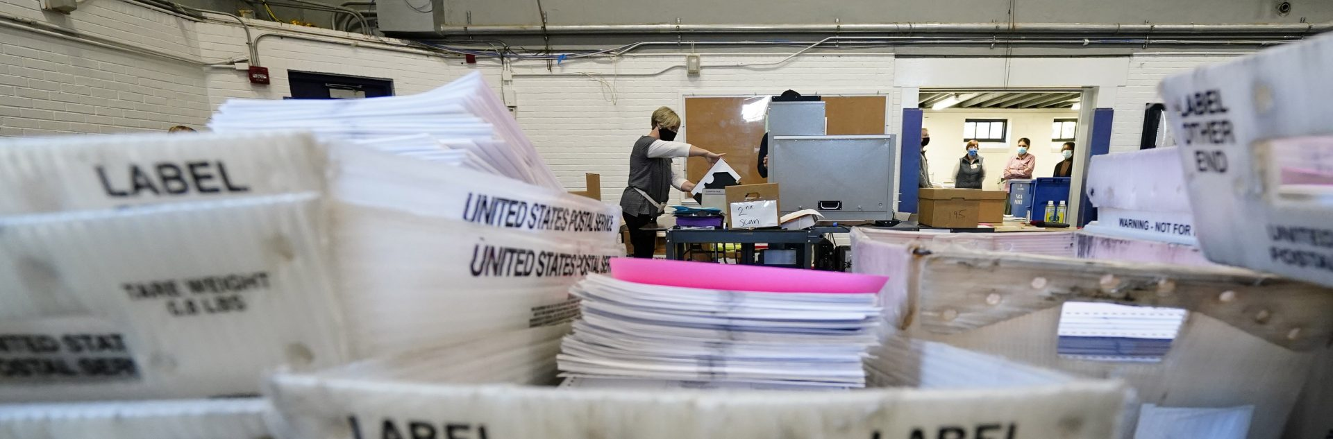 Chester County election workers scan mail-in and absentee ballots for the 2020 general election in the United States at West Chester University, Wednesday, Nov. 4, 2020, in West Chester.