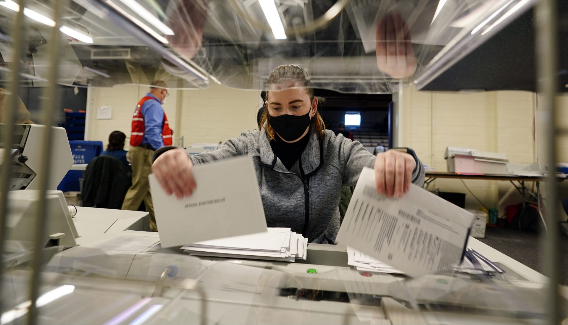 Chester County, Pa., election worker Kristina Sladek opens mail-in and absentee ballots for the 2020 General Election in the United States at West Chester University, Tuesday, Nov. 3, 2020, in West Chester, Pa.