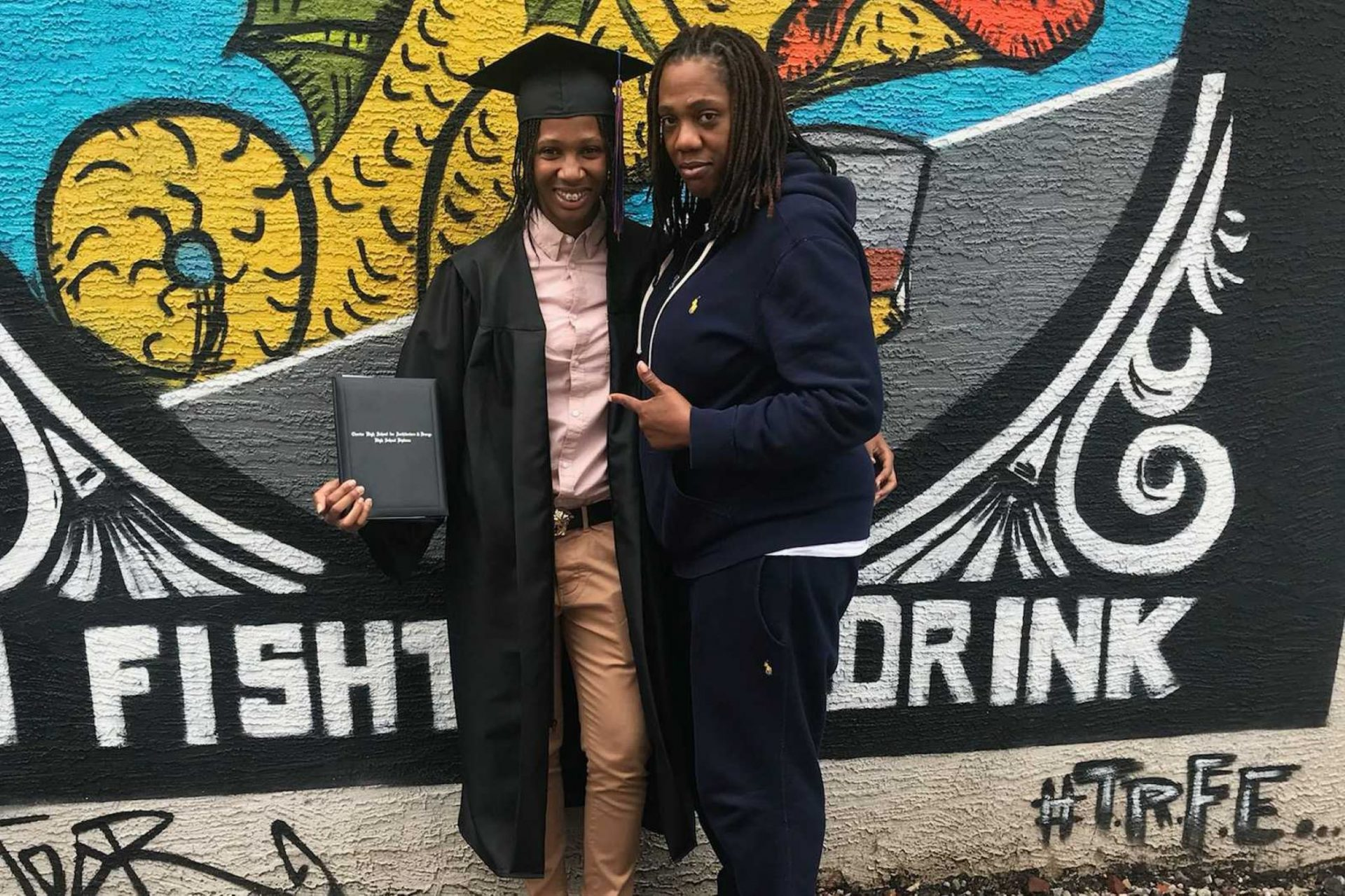 Aliyah Raye, right, and her mother Melanie Raye during her high school graduation.
