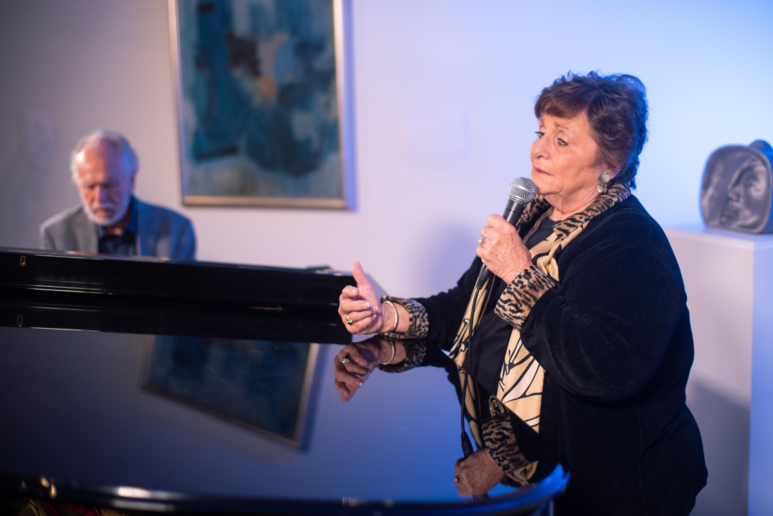 Cathy Chemi singing.