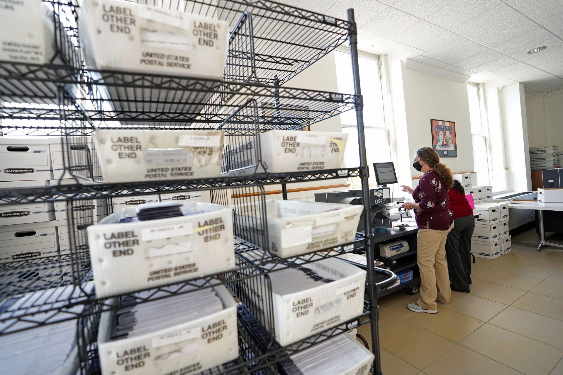 Mail ballots are sorted and counted by workers on Election Day 2020 at Northampton County Courthouse.