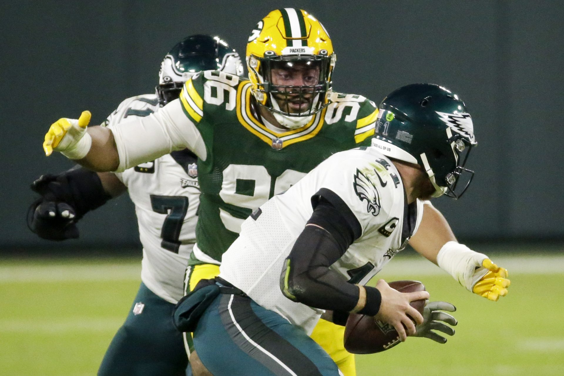 Green Bay Packers' Kingsley Keke sacks Philadelphia Eagles' Carson Wentz during the first half of an NFL football game Sunday, Dec. 6, 2020, in Green Bay, Wis.