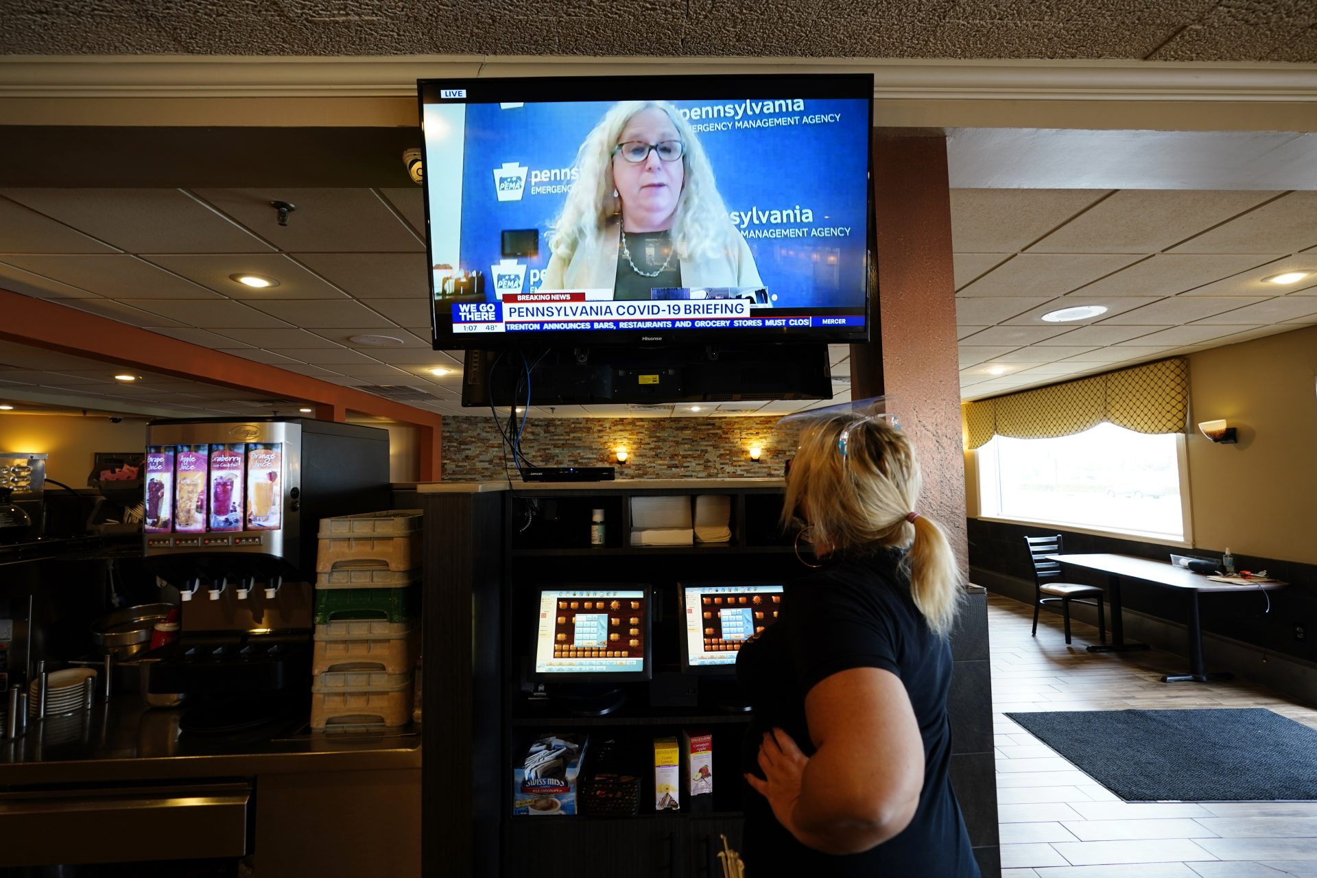 Waitress Lauren Musial watches a television briefing by Pennsylvania Health Secretary, Dr. Rachel Levine, at the Penrose Diner, Tuesday, Nov. 17, 2020, in South Philadelphia.