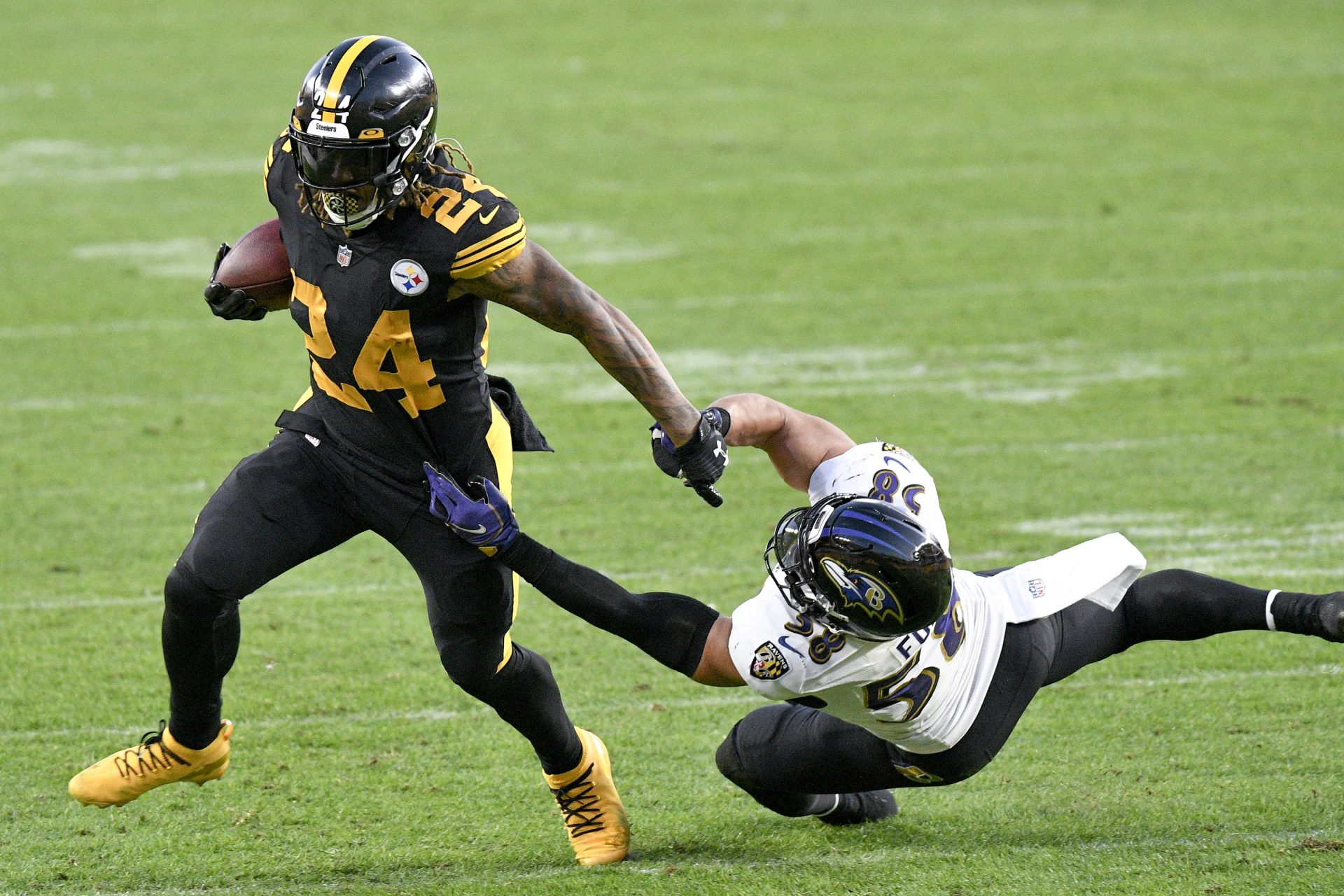Pittsburgh Steelers running back Benny Snell (24) runs away from Baltimore Ravens outside linebacker L.J. Fort (58) during the first half of an NFL football game, Wednesday, Dec. 2, 2020, in Pittsburgh.