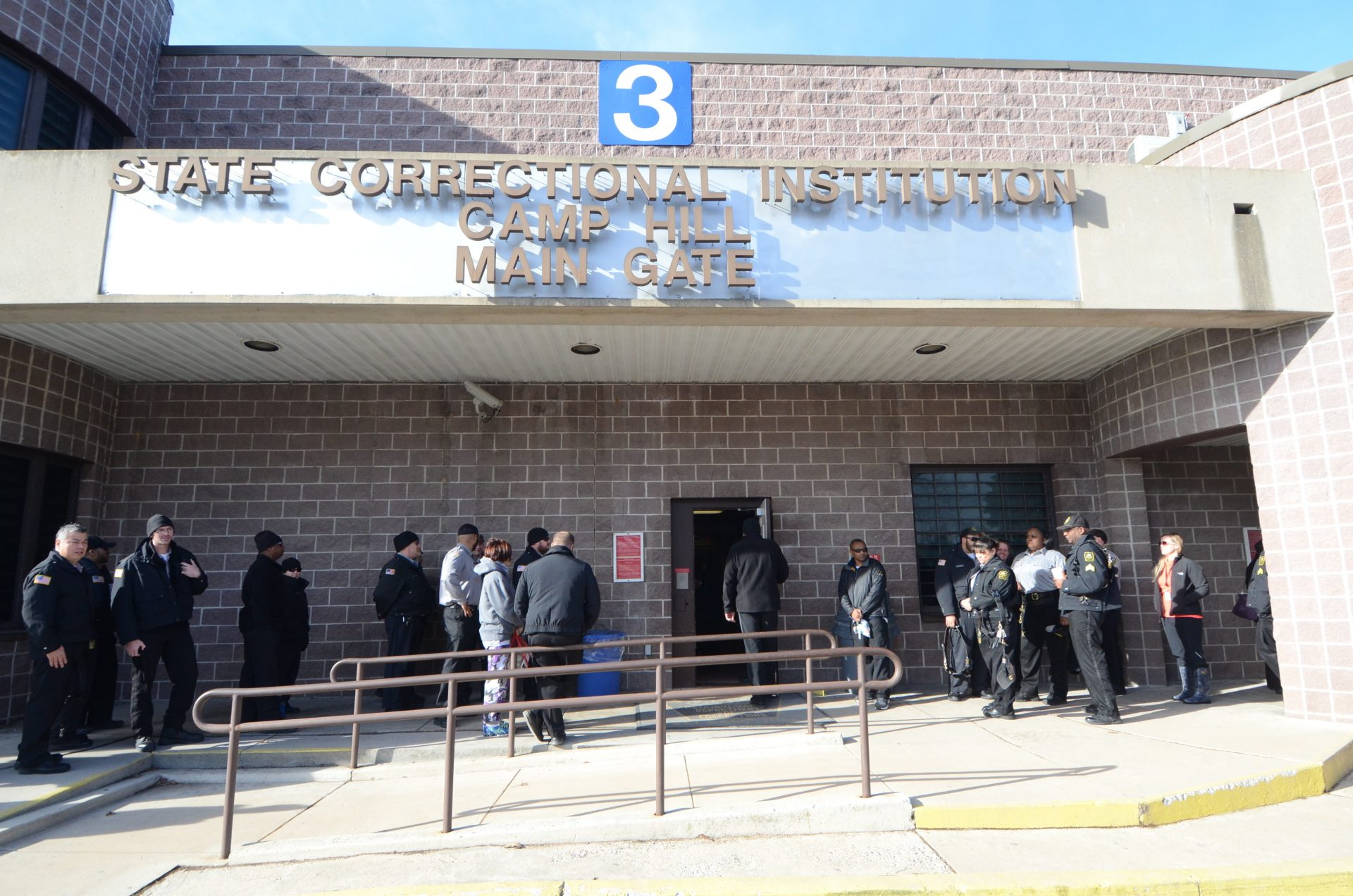 FILE PHOTO: Corrections officers arrive for their shift at the State Correctional Institution at Camp Hill on Jan. 13, 2017, in Camp Hill, Pa.