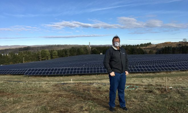 Cory Miller, executive director of the University Area Joint Authority, in the State College area of Centre County, standing in front of a UAJA solar panel project.