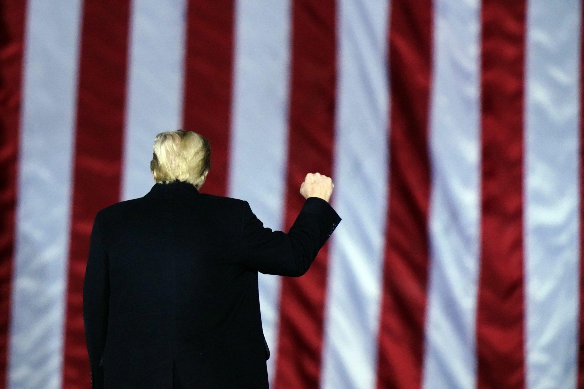 President Donald Trump gestures at a campaign rally in support of U.S. Senate candidates Sen. Kelly Loeffler, R-Ga., and David Perdue in Dalton, Ga., Monday, Jan. 4, 2021.