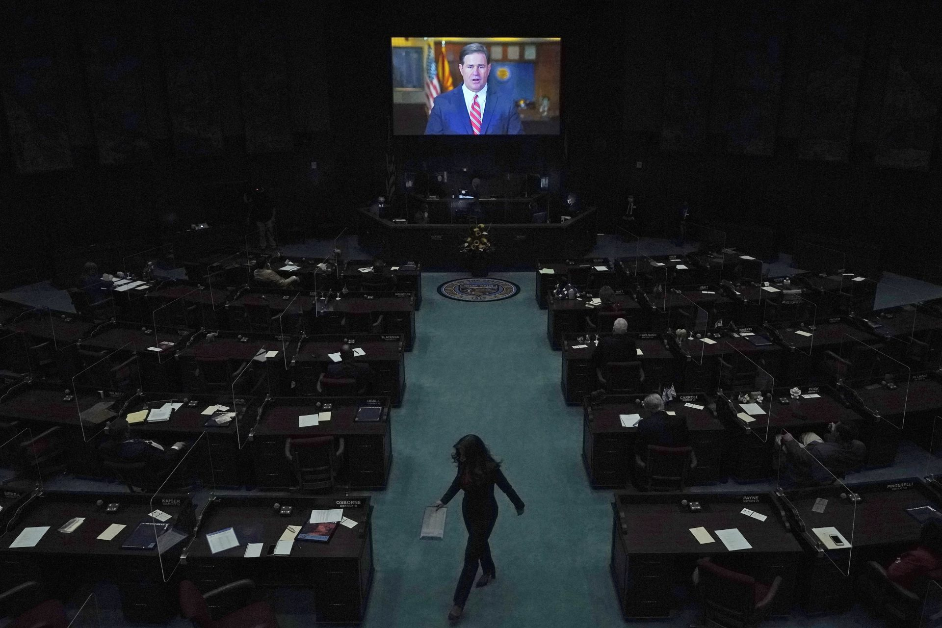 In this Jan. 11, 2021, file photo, Republican Gov. Doug Ducey delivers a remote state of the state address during the opening of the Arizona Legislature at the state Capitol in Phoenix. Irked by the sweeping use of executive orders during the COVID-19 crisis, state lawmakers around the U.S. are moving to curb the authority of governors and top health officials to impose emergency restrictions such as mask rules and business shutdowns. Republicans in the Arizona Senate want to end the broad emergency powers that Ducey has used to limit large gatherings and business capacities.